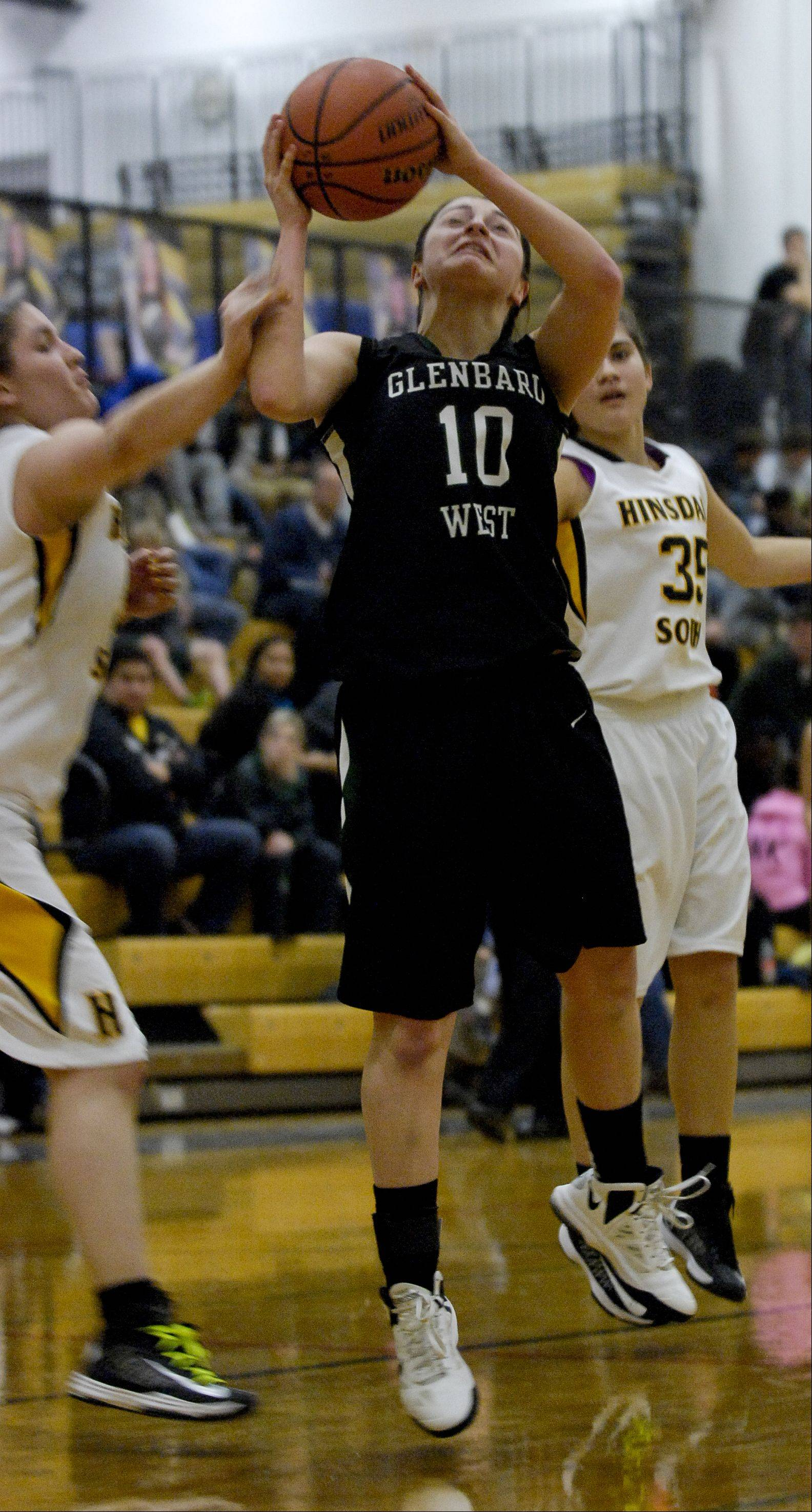 Abby Keirnan of Glenbard West heads to the hoop against Hinsdale South.