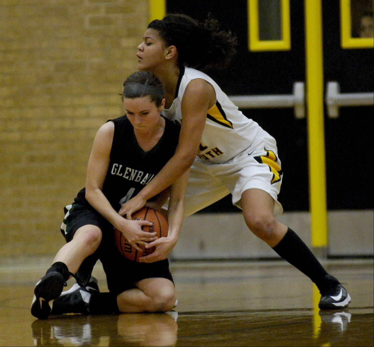Tracy Flood of Glenbard West and Toni Romiti of Hinsdale South battle for control of the ball.
