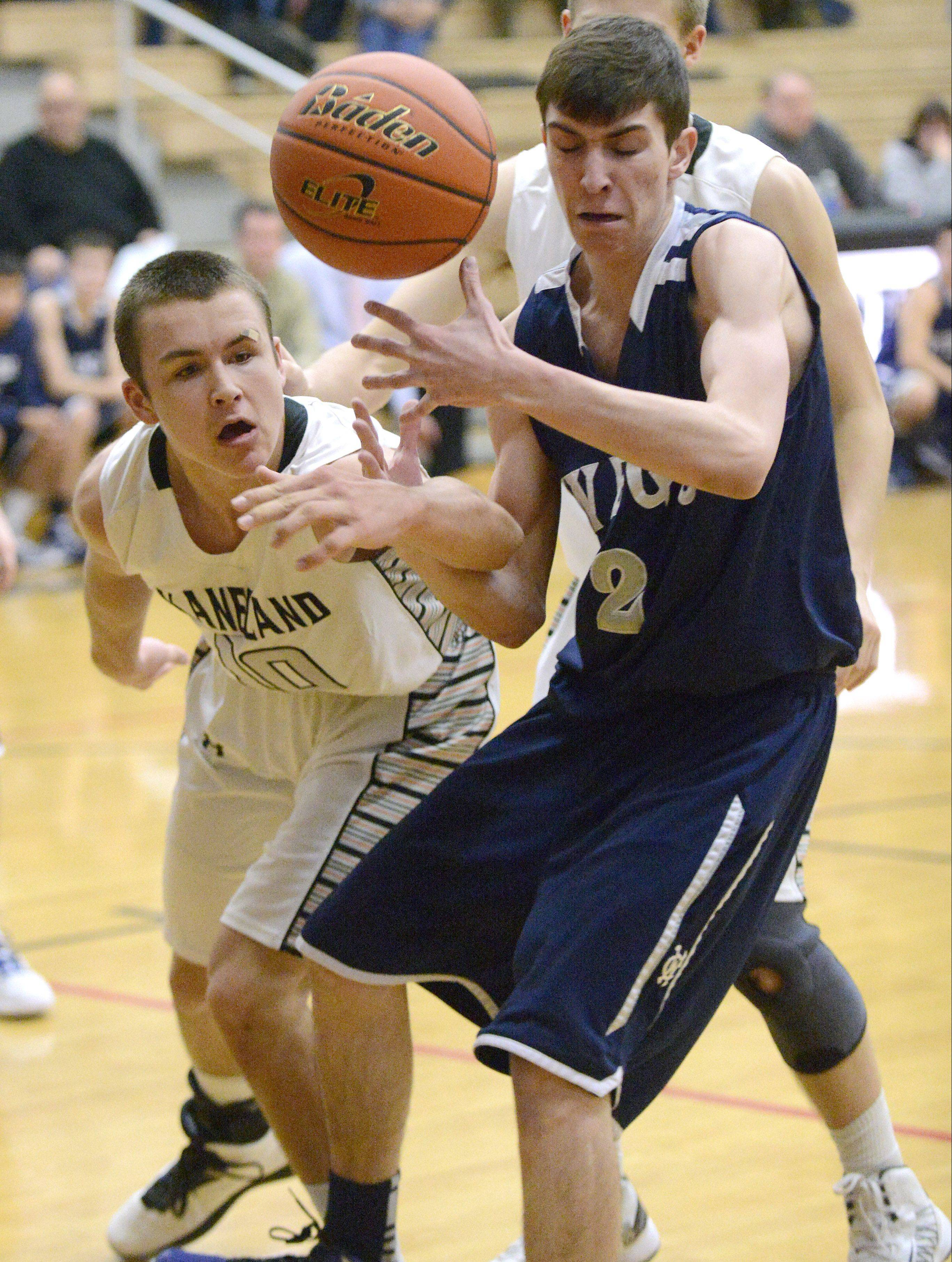 West Chicago's Jimmy Rizzo and Kaneland's Tyler Carlson fight for a loose ball in the second quarter on Tuesday.