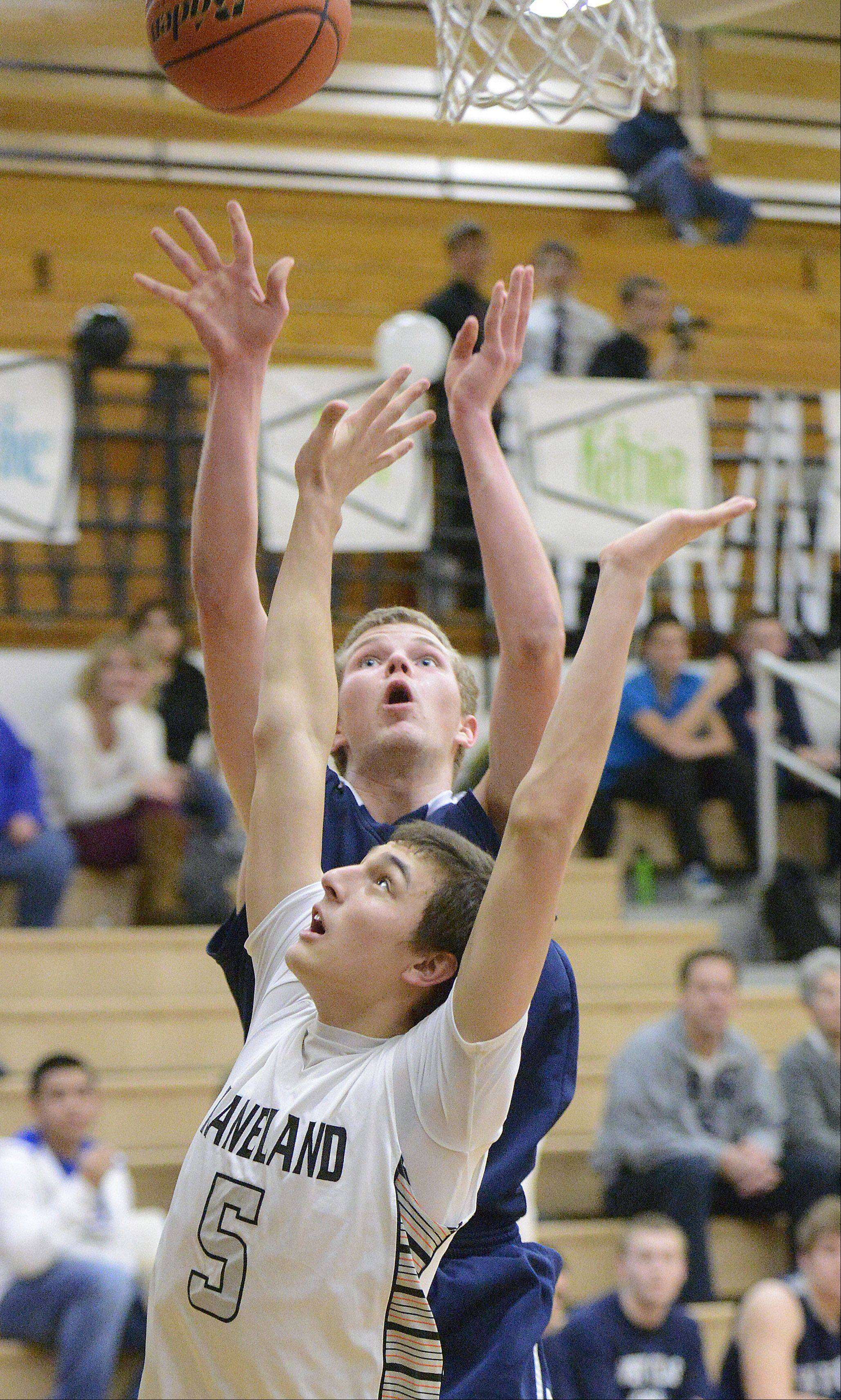 West Chicago's Mike Zajac shoots over a block by Kaneland's John Pruett in the third quarter on Tuesday, February 5.