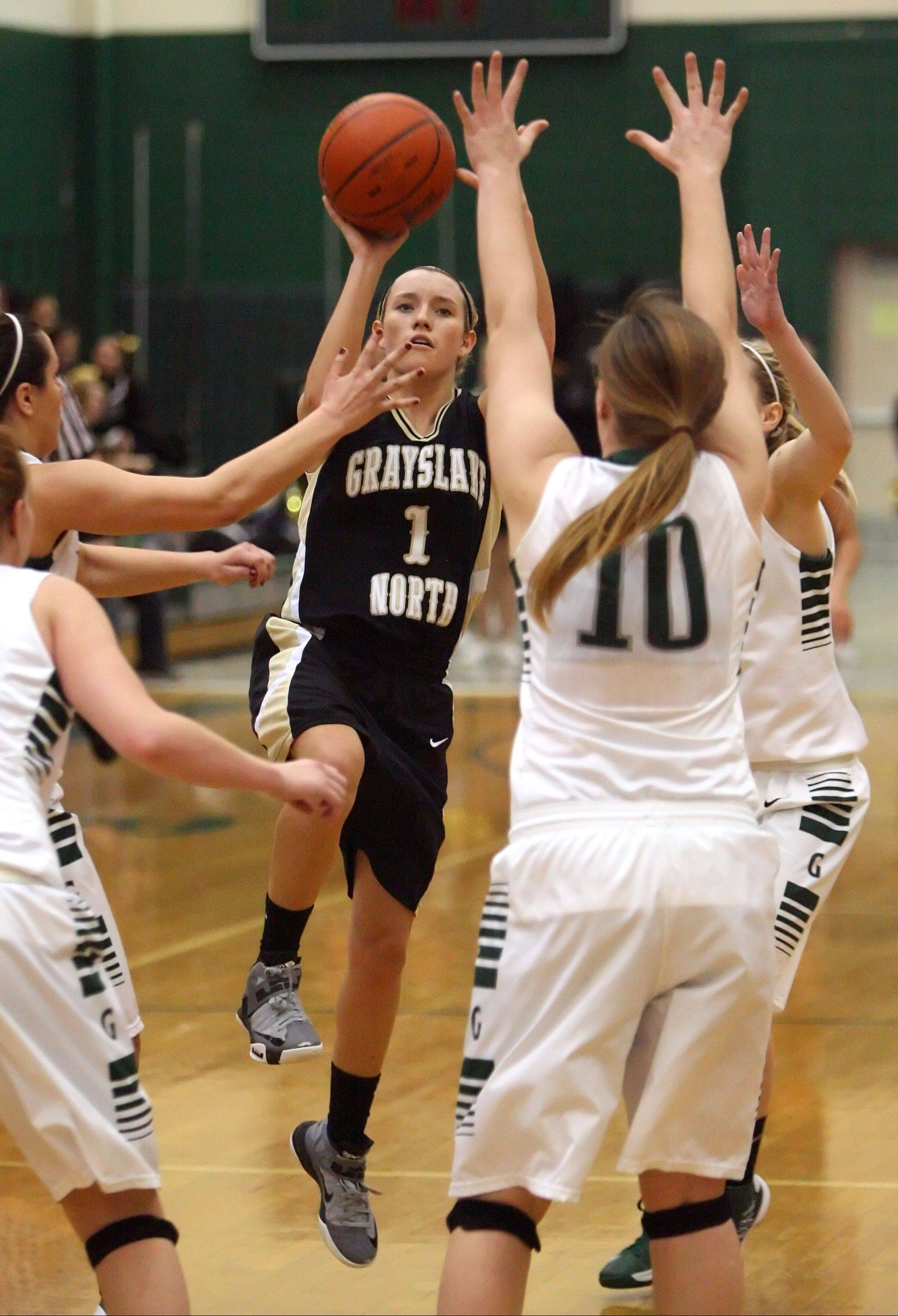 Grayslake North's Jordyn Bowen takes a shot at the end of the first half over Grayslake Central's Maddy Miller on Tuesday night at Grayslake Central.