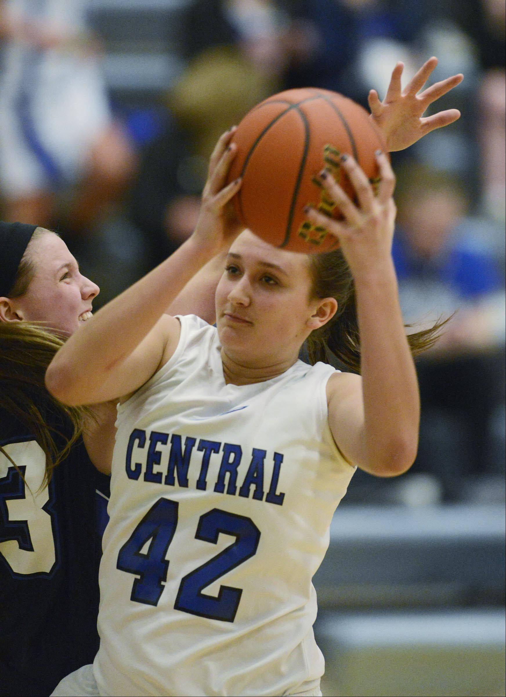 Burlington Central's Alison Colby (42) gets past St. Charles North's Nicole Davidson Tuesday in Burlington.