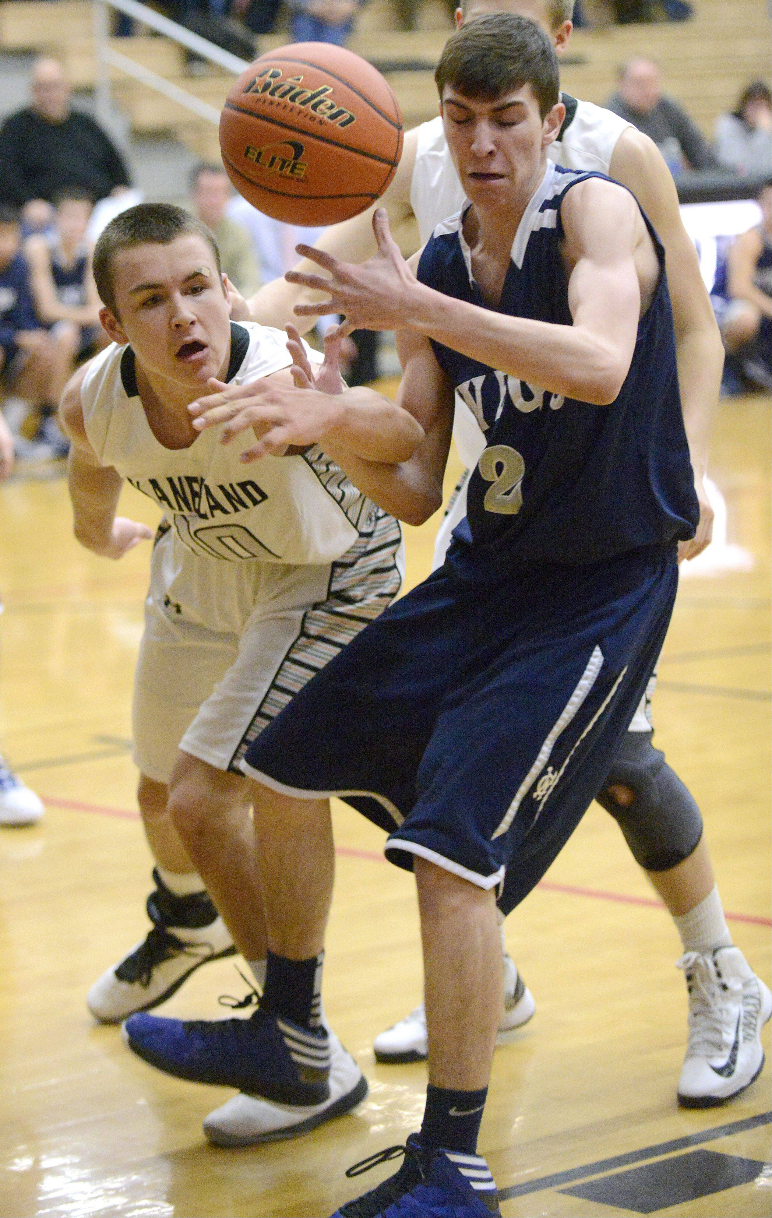 West Chicago's Jimmy Rizzo and Kaneland's Tyler Carlson fight for a loose ball in the second quarter.