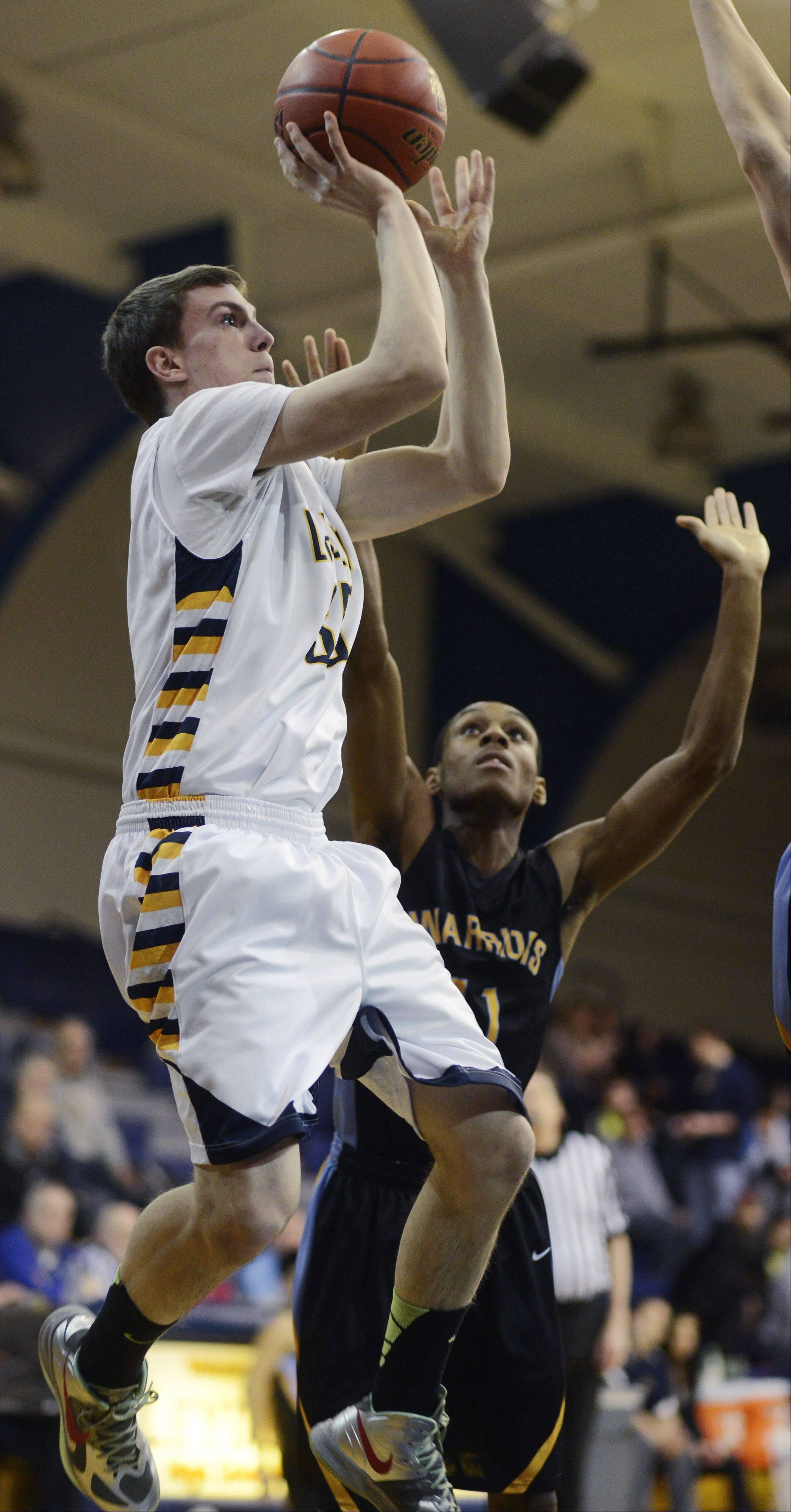 Leyden's Jonny Woolf, left, takes a shot against the Maine West defense including Allante Bates.
