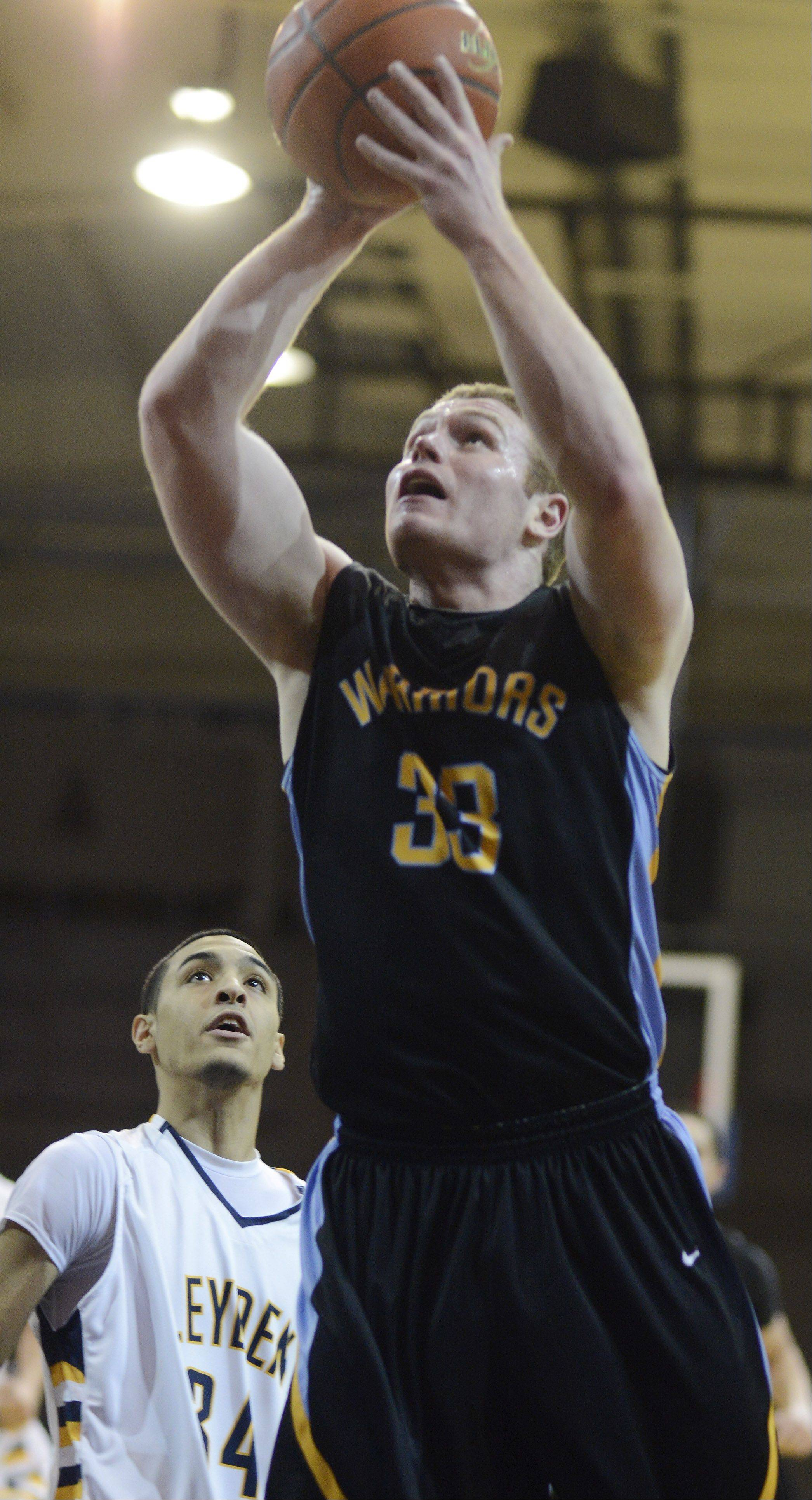 Maine West's Matt Finnander makes a strong move to the basket as he moves past Leyden's Adrian Vallejo.