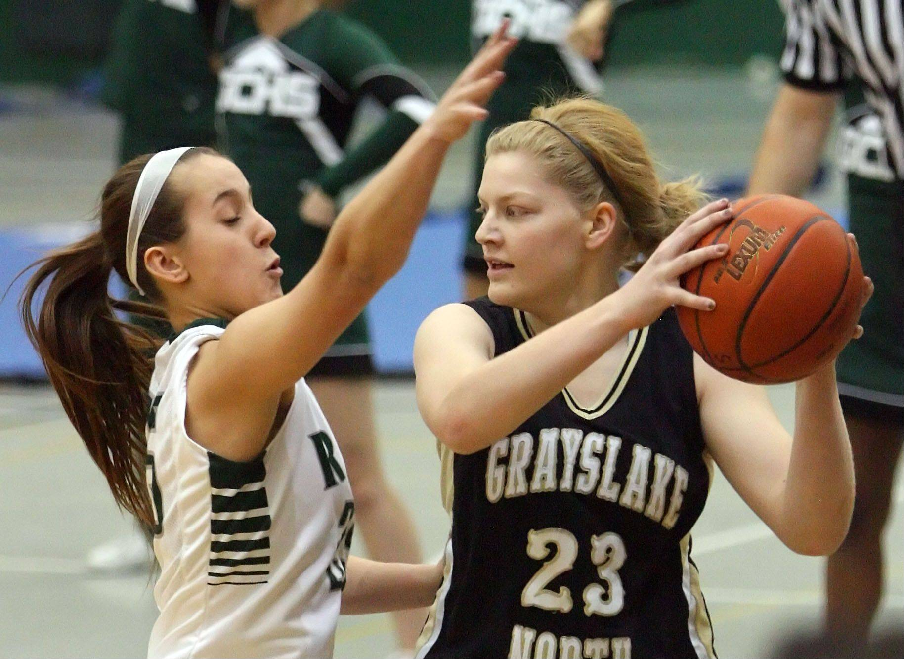Grayslake Central's Taylor Peterson, left, ddefends against Grayslake North's Joanna Guhl.
