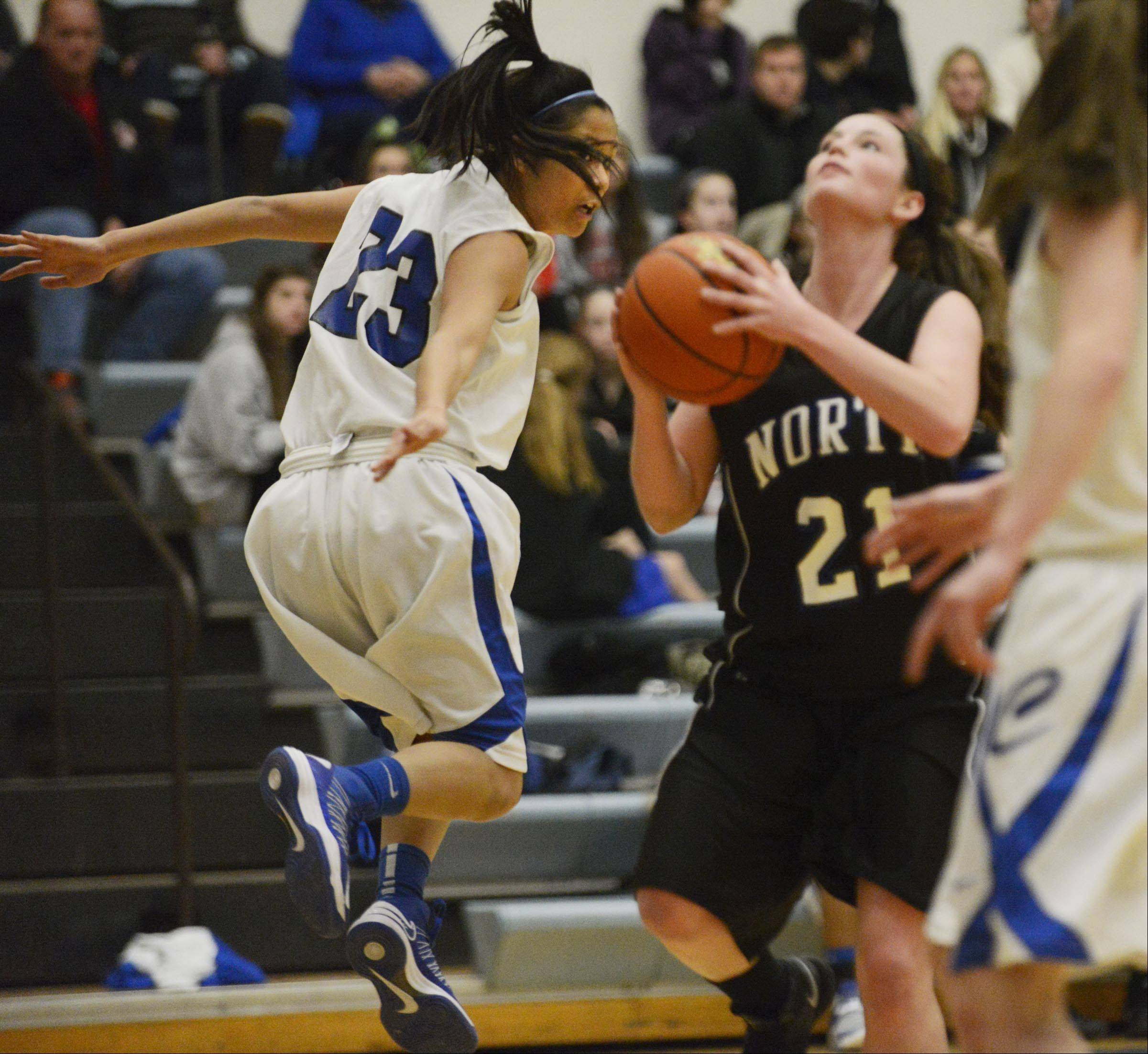 Burlington Central's Camille Delacruz flies past St. Charles North's Alex Silverman.