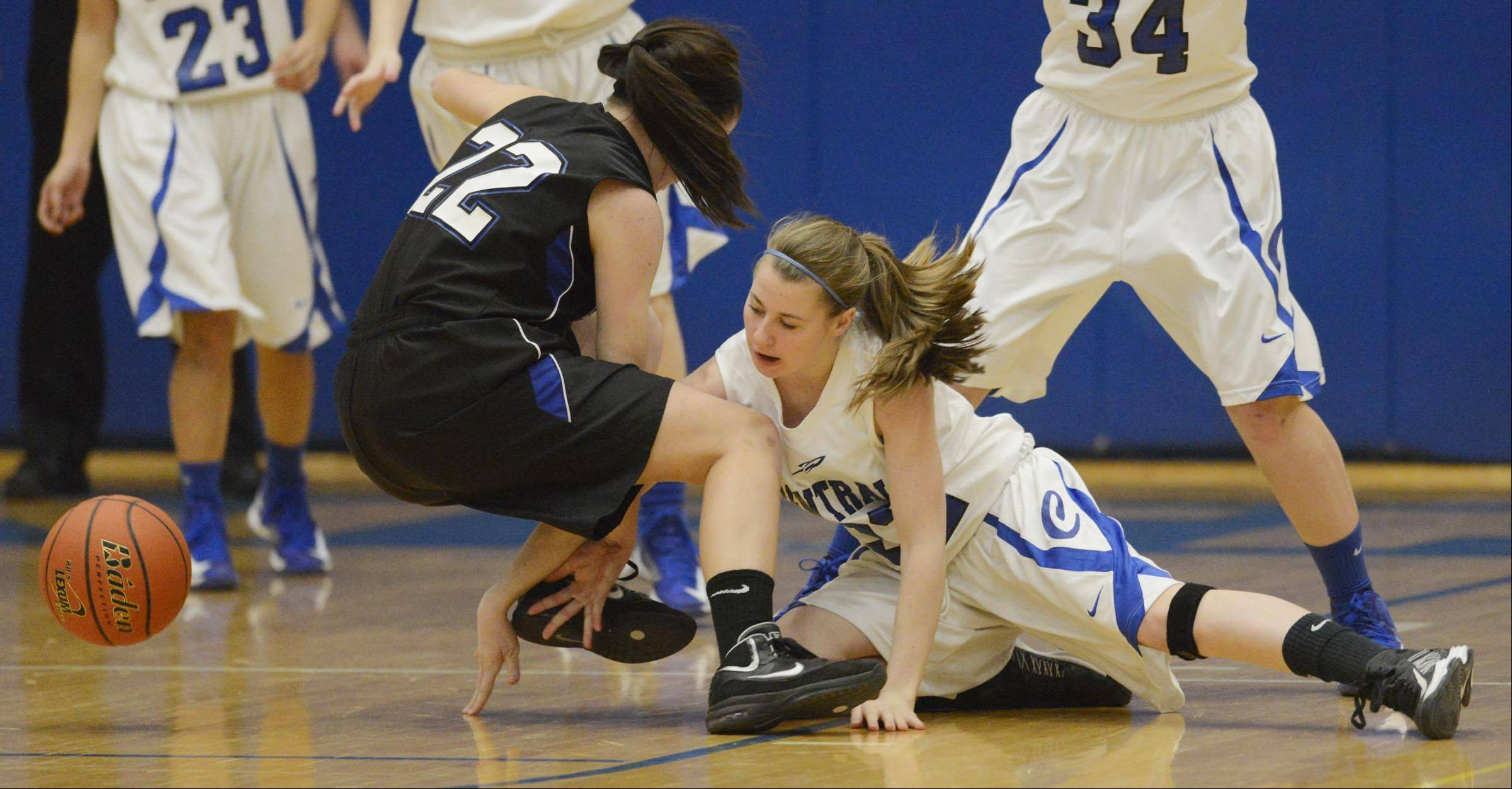 Burlington Central's Aly DeTamble punches the ball away from St. Charles North's Kayla Balousek.