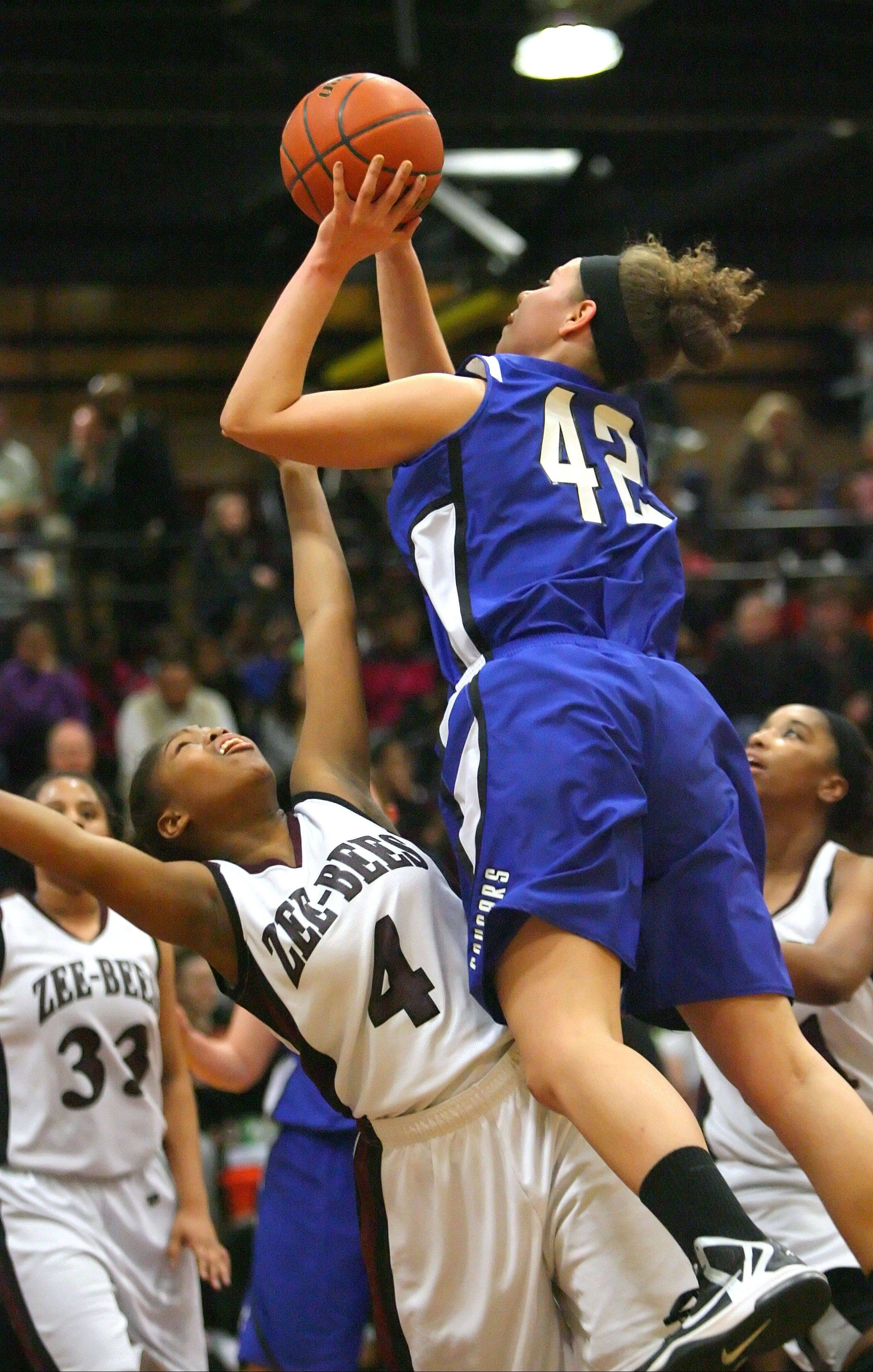 Vernon Hills' Lauren Webb, right, drives on Zion-Benton's Krystal Walker during the NSC title game Wednesday night at Zion-Benton.