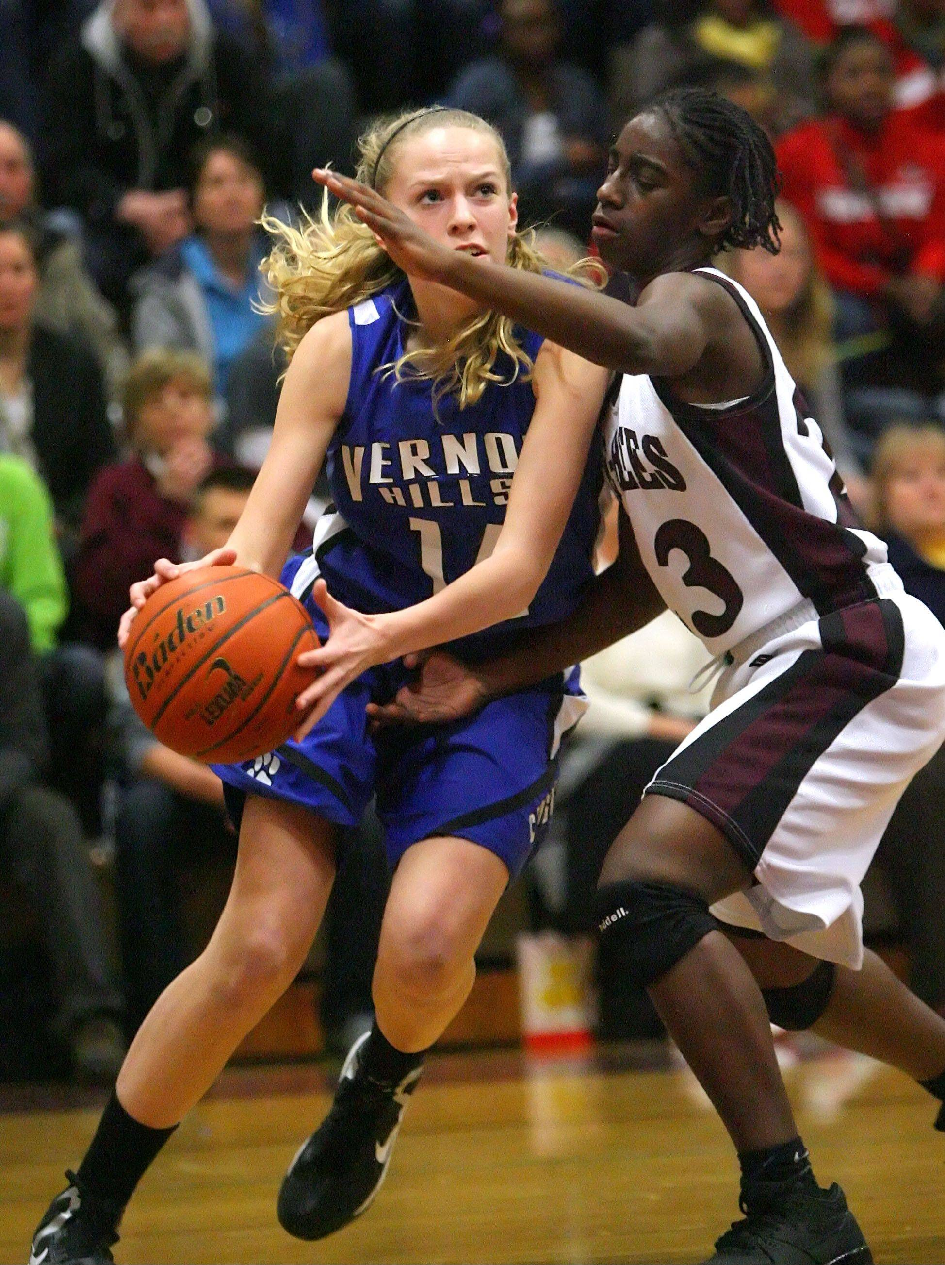 Vernon Hills' Kasey Firnbach, left, drives on Zion-Benton's TT Maggett during the NSC title game Wednesday night at Zion-Benton.