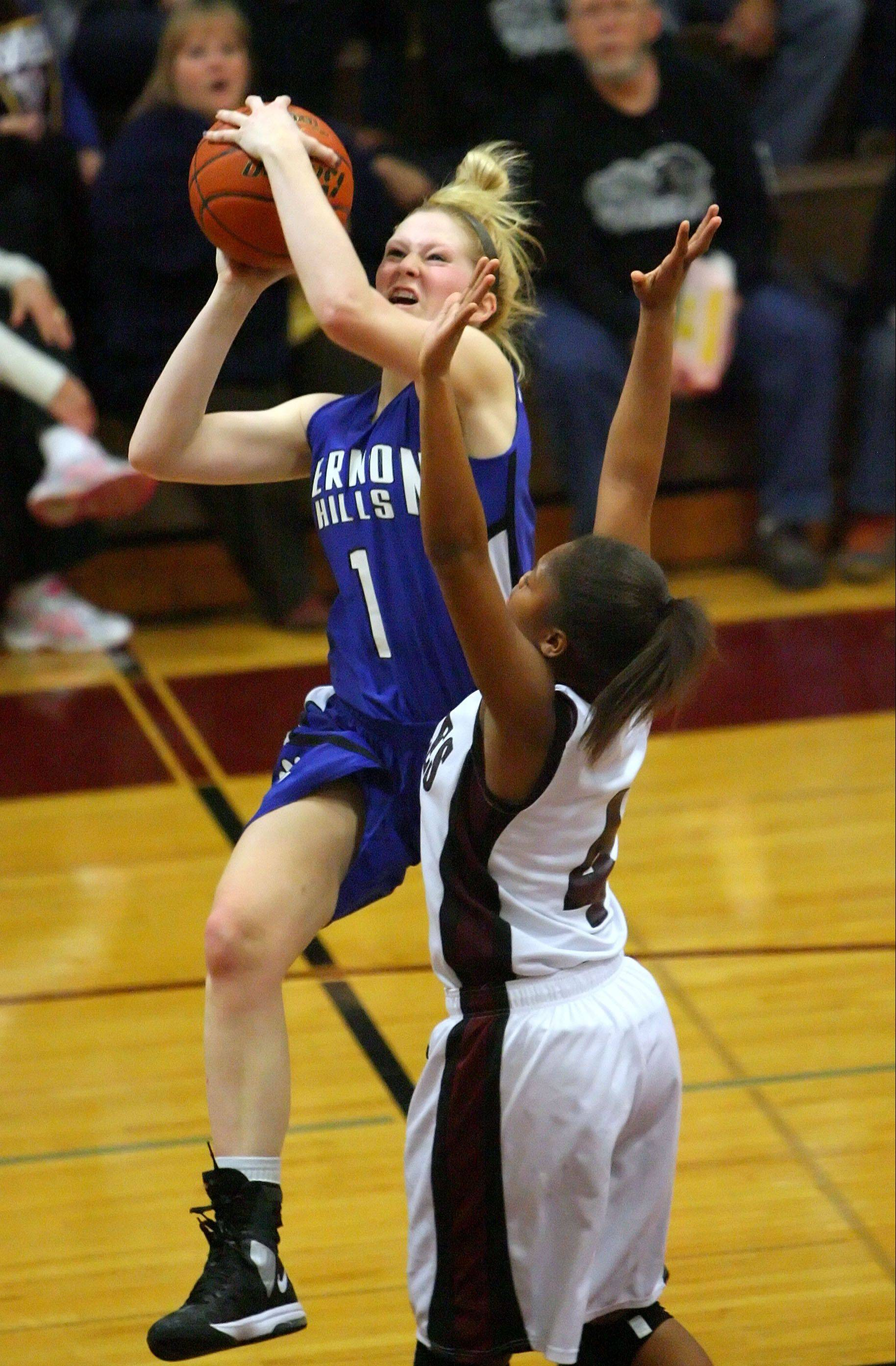 Vernon Hills' Sydney Smith, left, drives on Zion-Benton's Krystal Walker during the NSC title game Wednesday night at Zion-Benton.