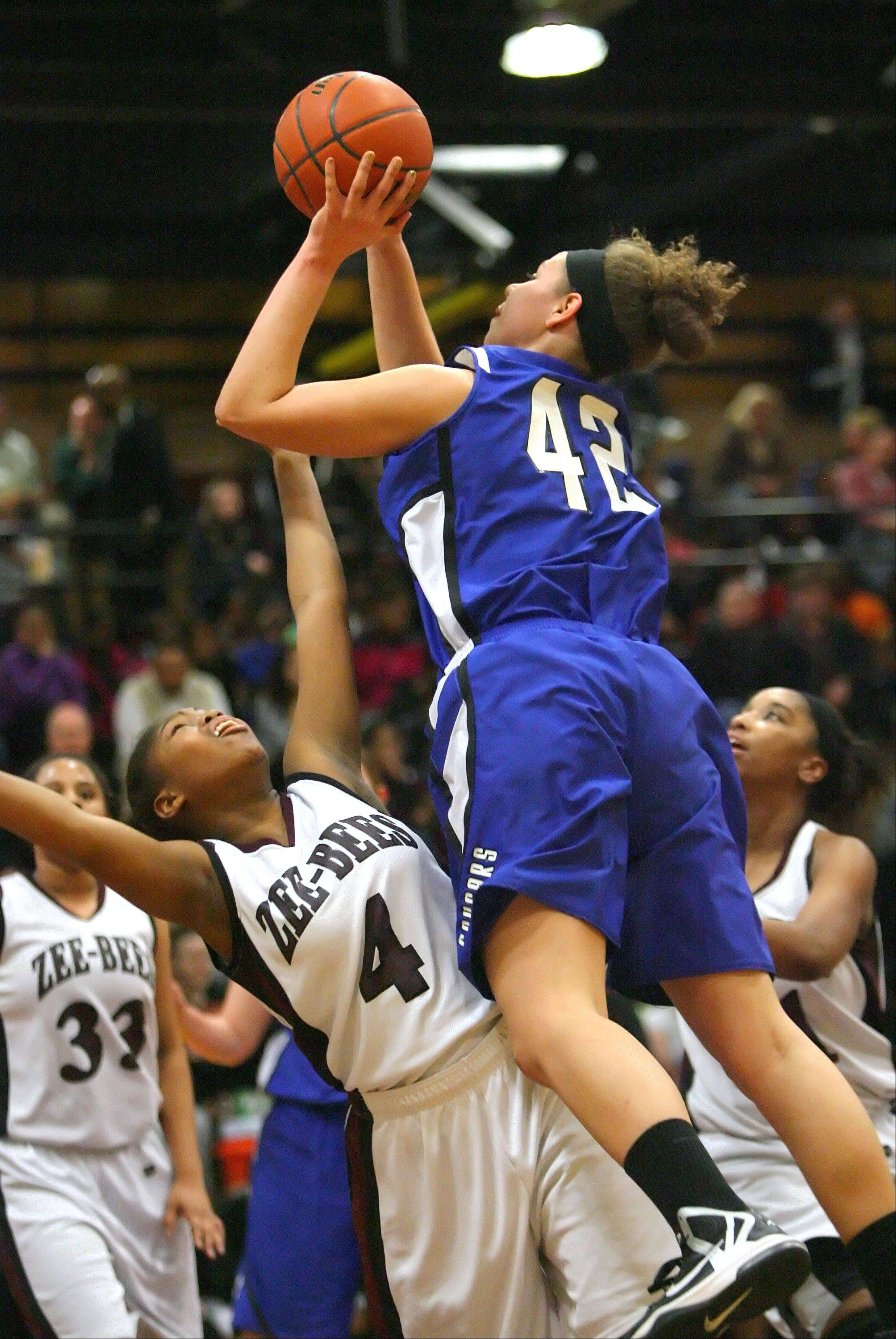 Vernon Hills' Lauren Webb, right, drives on Zion-Benton's Krystal Walker.