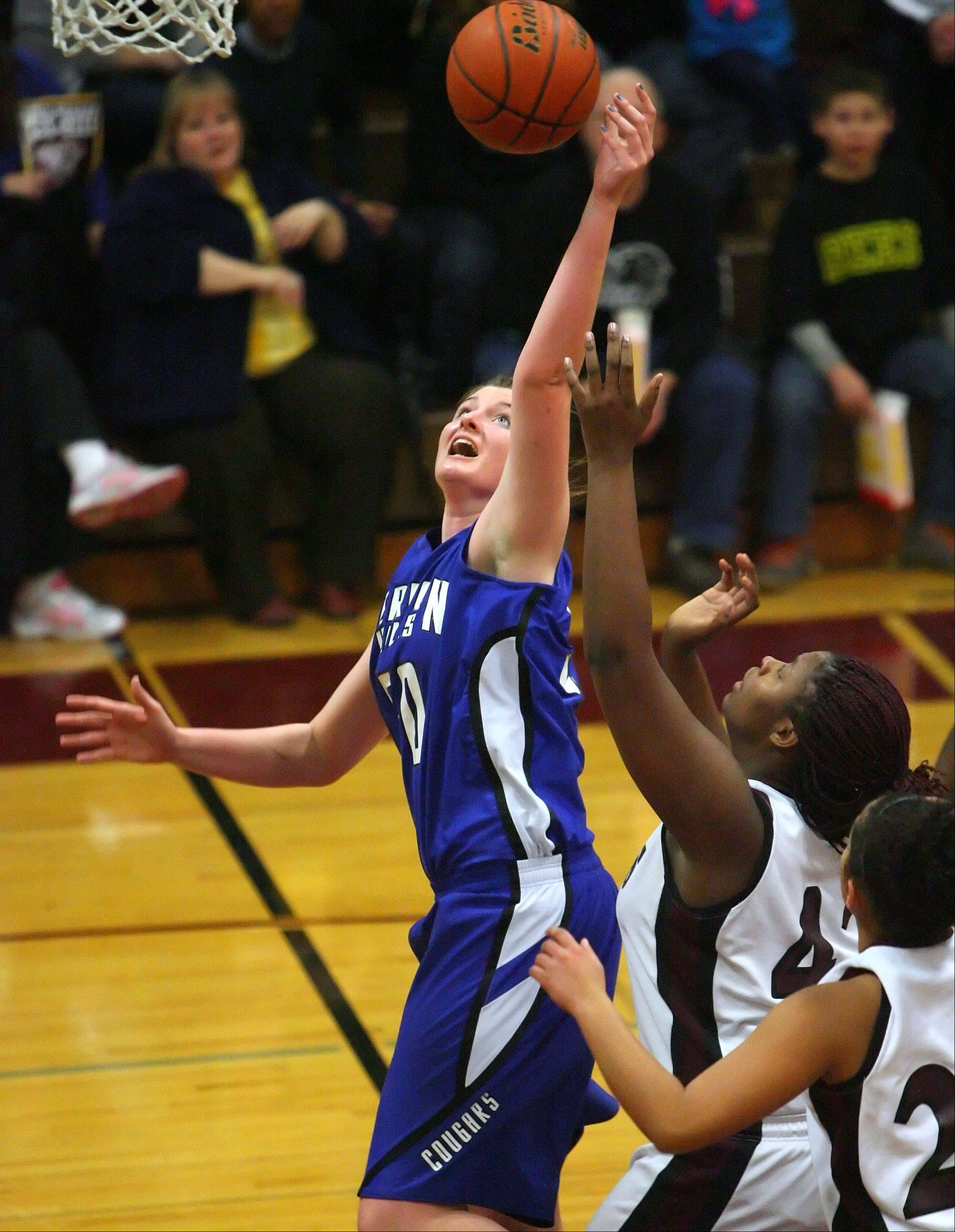 Vernon Hills' Meri Bennett-Swanson, left drives on Zion-Benton's Mia Yarbrough.
