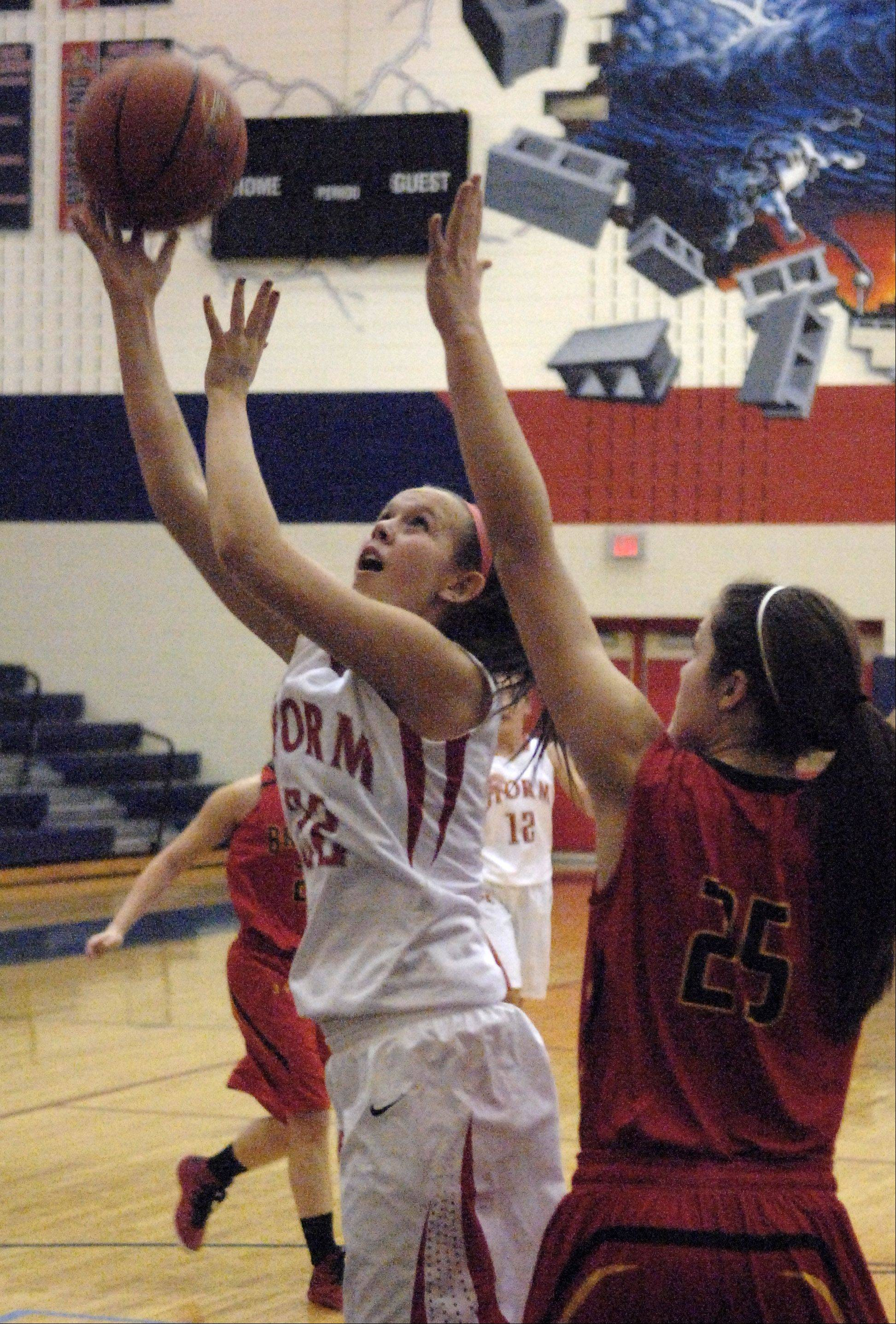 South Elgin's Laura McIntosh puts up a shot over Batavia's Hannah Frazier.