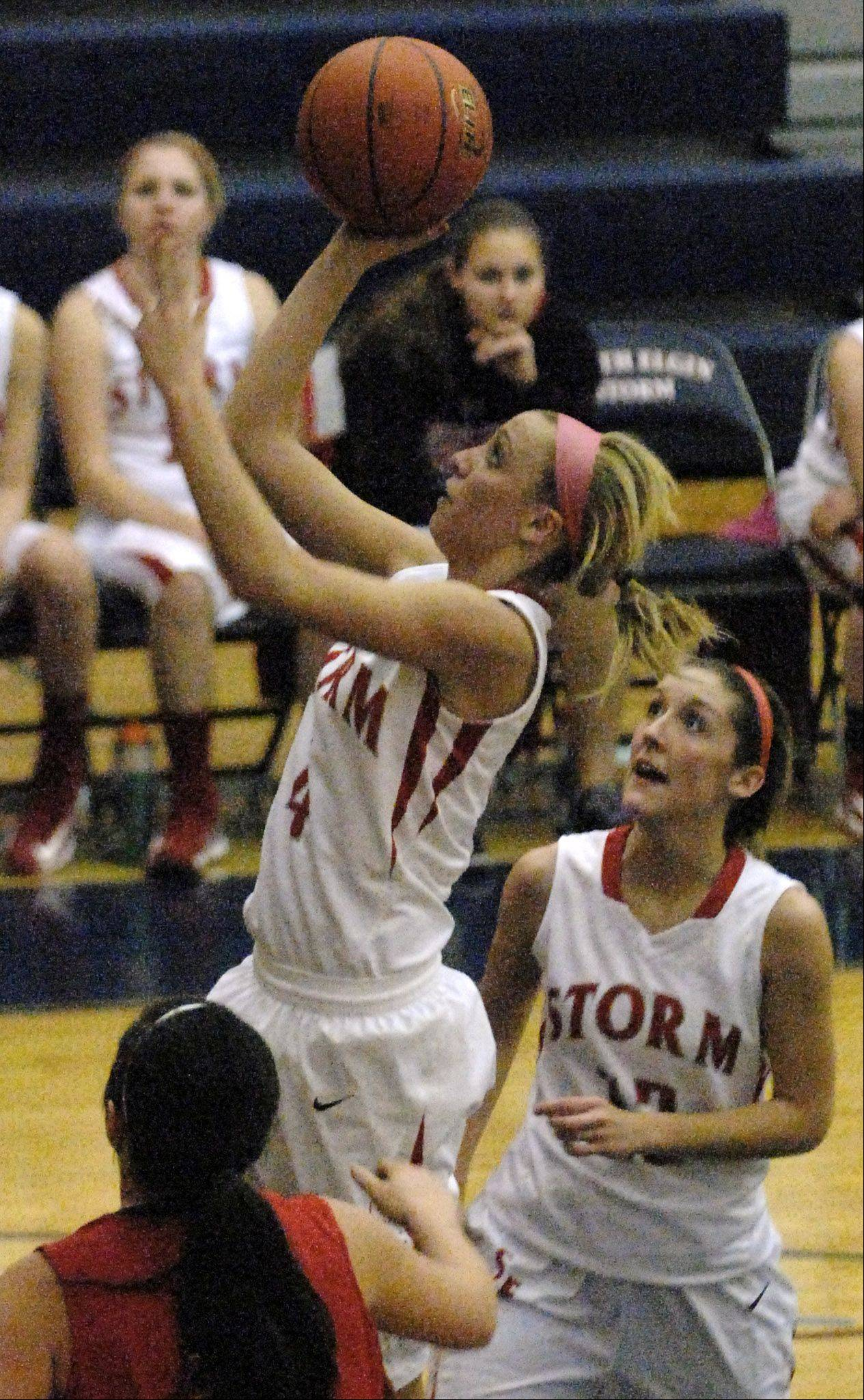 South Elgin's Savanah Uveges scores.