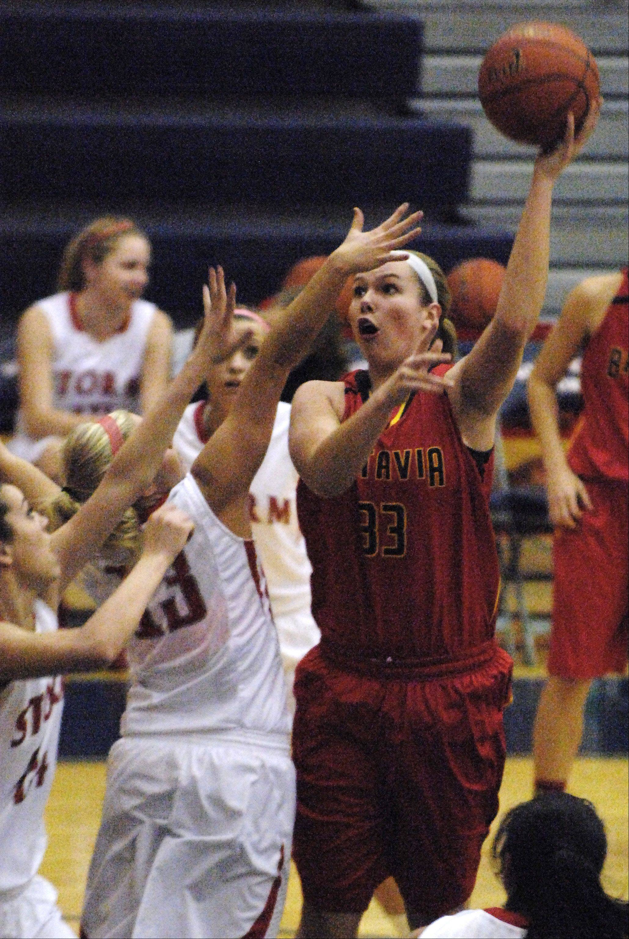 Batavia's Erin Bayram shoots over a pair of South Elgin defenders.
