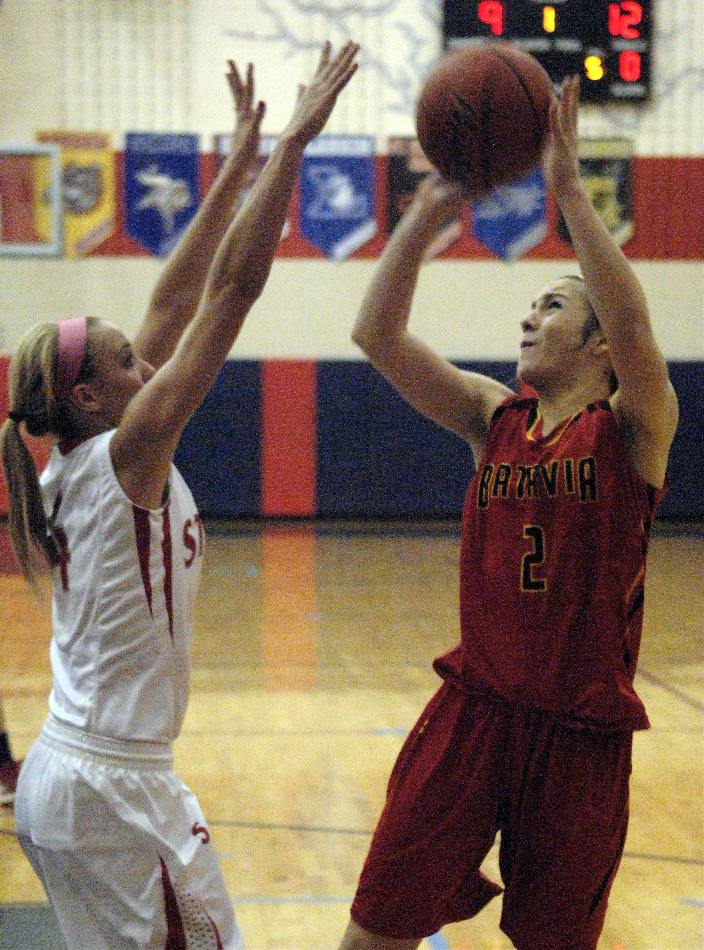 Batavia's Grace Andrews shoots over South Elgin's Savanah Uveges.