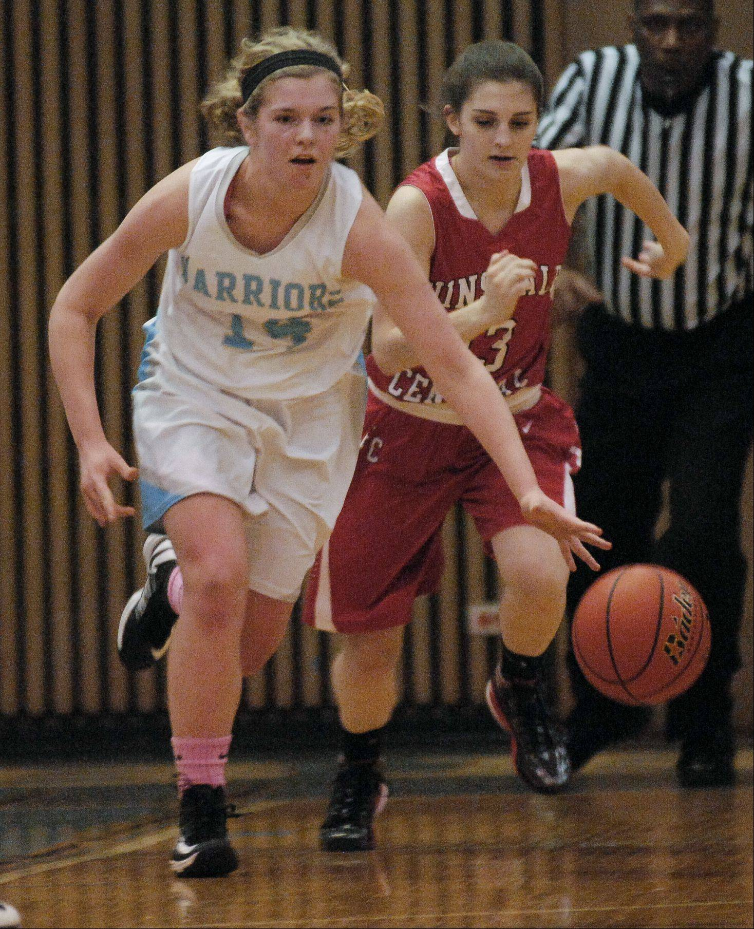 Lauren Carroll of Willowbrook breaks away from Payton Katich of Hinsdale Central Wednesday night during girls basketball in Vila Park.
