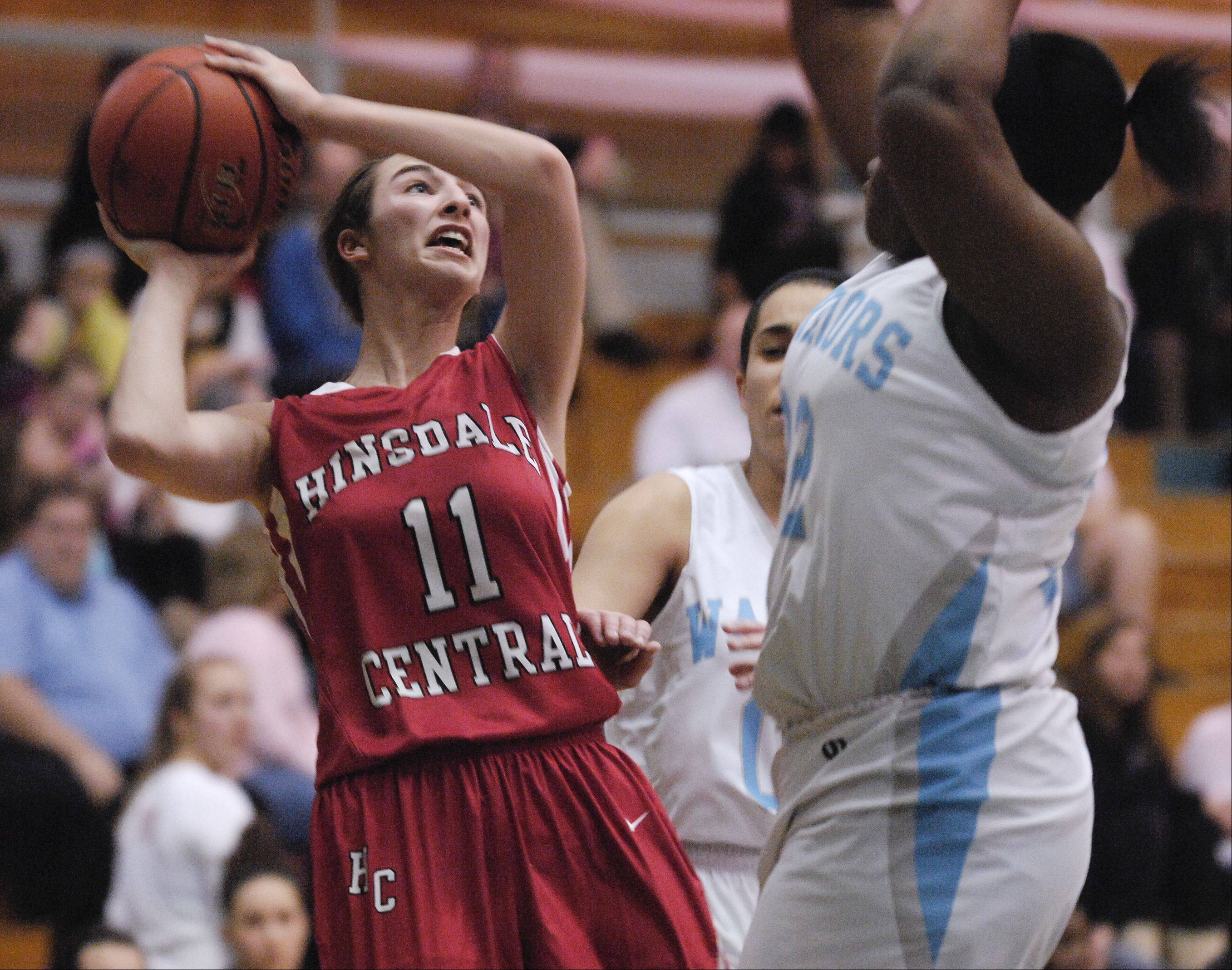 Maddie Roglich of Hinsdale Central looks to take a shot over Erma Udota of Willowbrook Wednesday night during girls basketball in Vila Park.