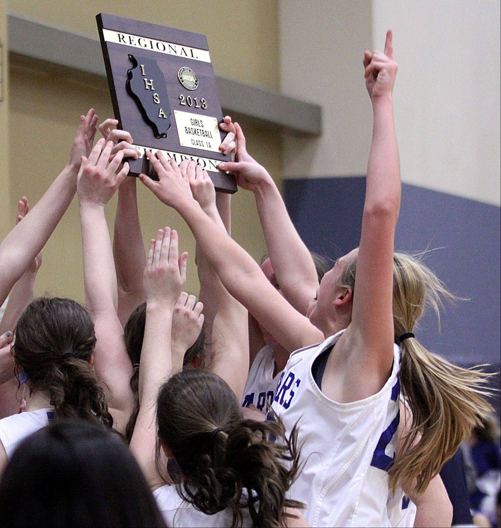 Westminster Christian players raise their hardware after beating Christian Liberty Academy 62-43 for the Class 1A Harvest Christian regional championship Friday.