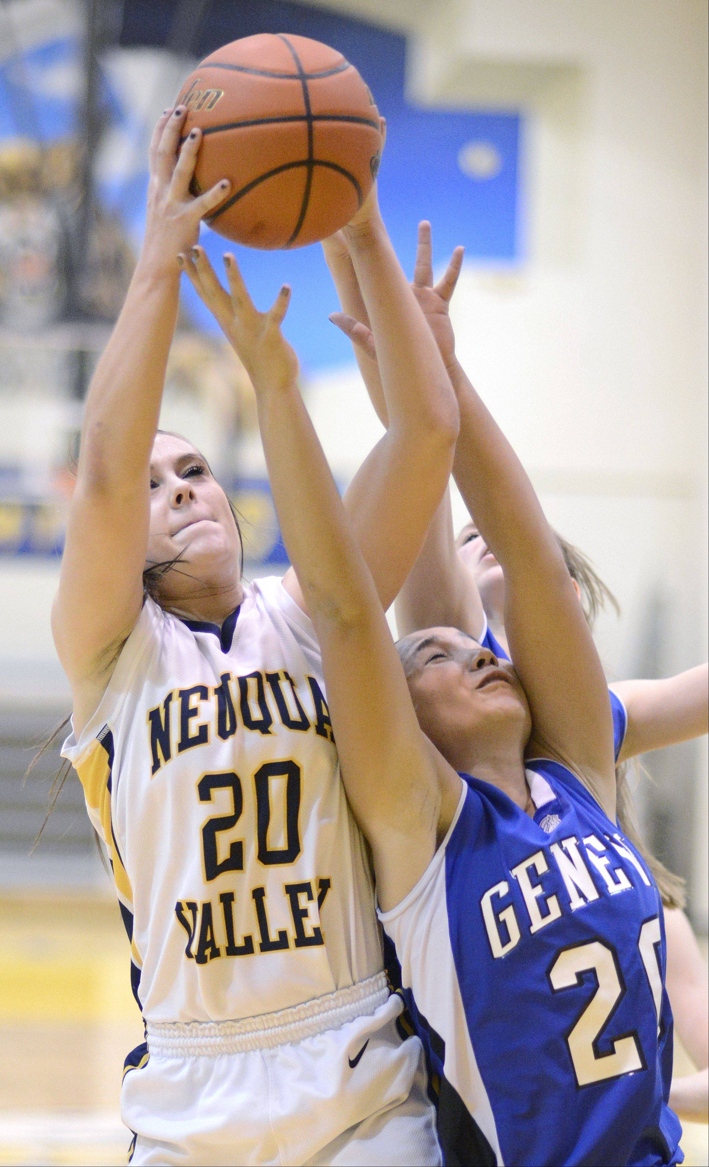 Neuqua Valley's Niki Lazar and Geneva's Kelly Gordon leap for a rebound in the fourth quarter of the Upstate Eight championship on Friday, February 8.