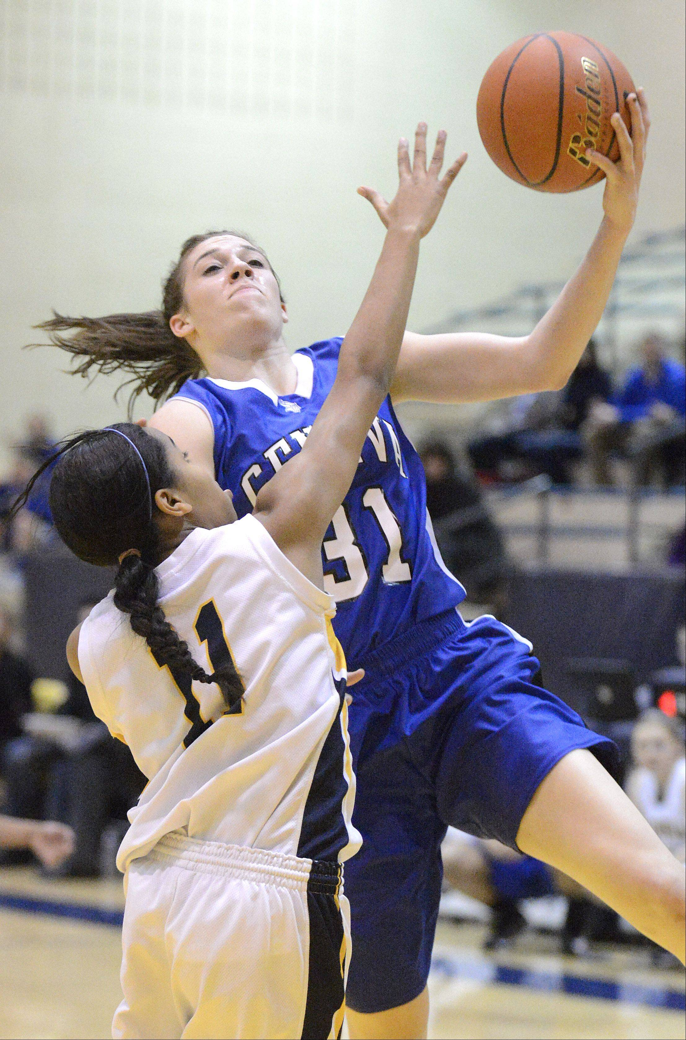 Laura Stoecker/lstoecker@dailyherald.comNeuqua Valley's Kai Moon attempts to block a shot by Geneva's Sami Pawlak in the first quarter of the Upstate Eight championship on Friday, February 8.
