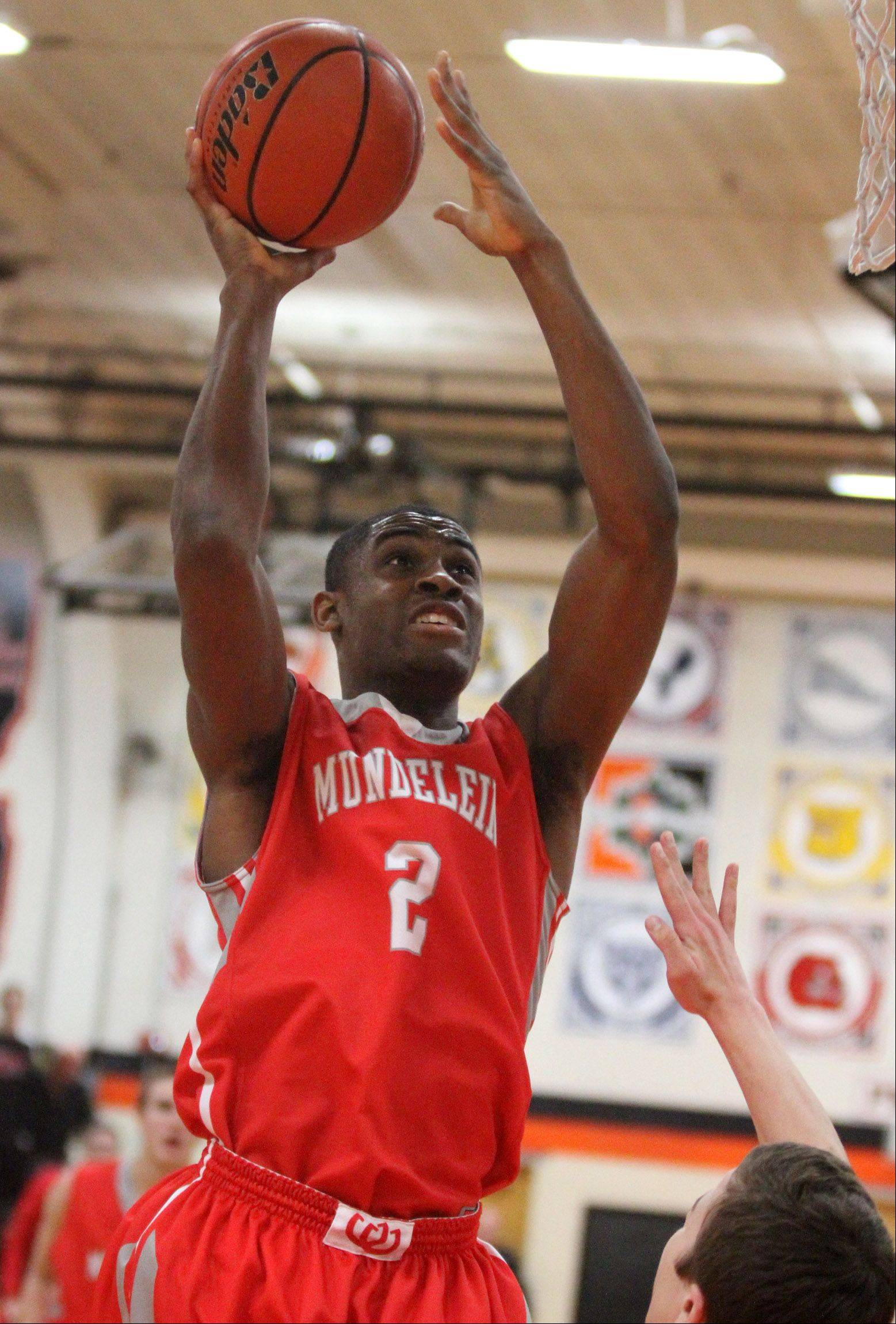 Libertyville forward Chino Ebube shoots against Mundelein.