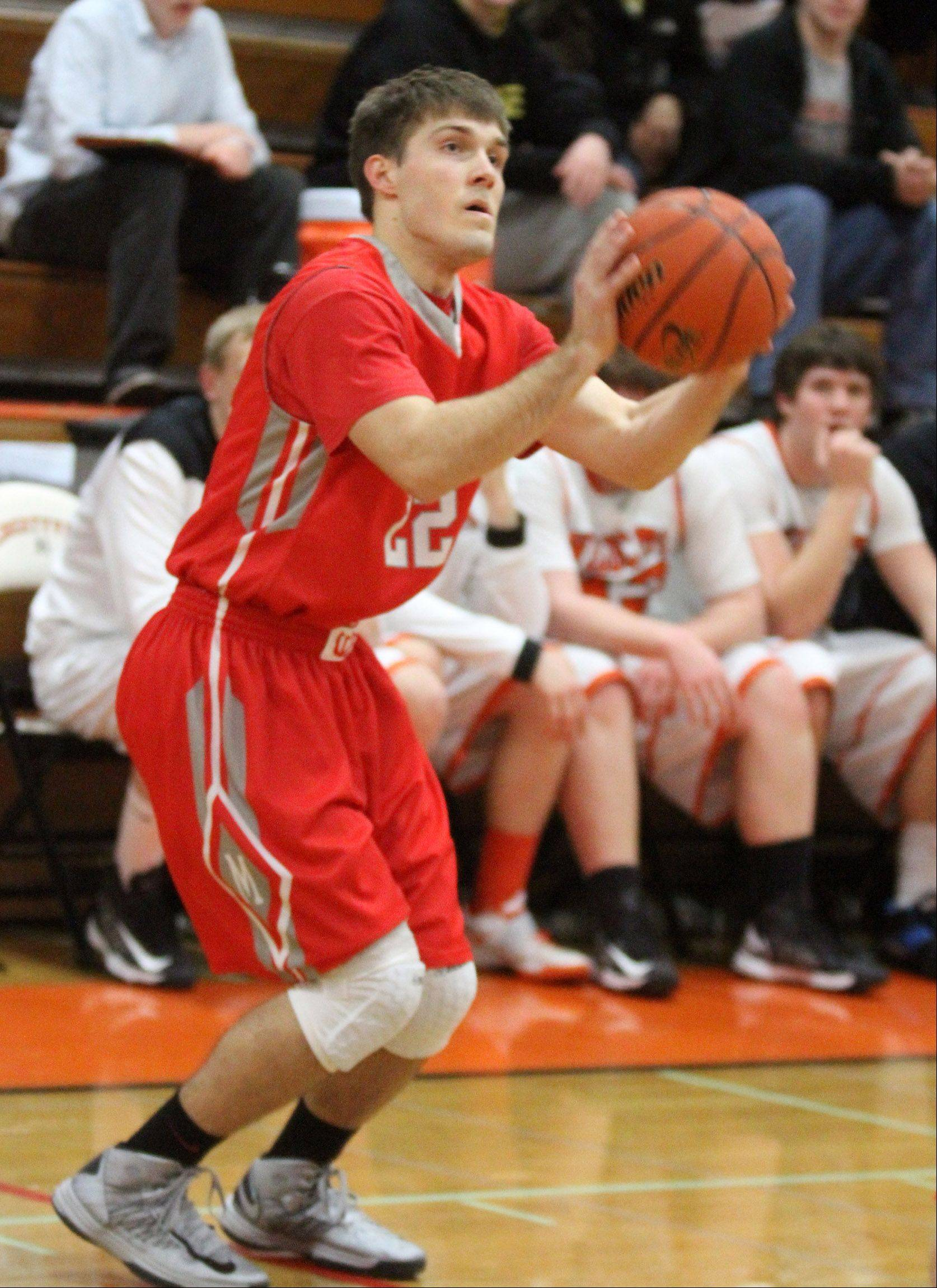 Mundelein guard Robert Knar shoots against Libertyville in the first half.