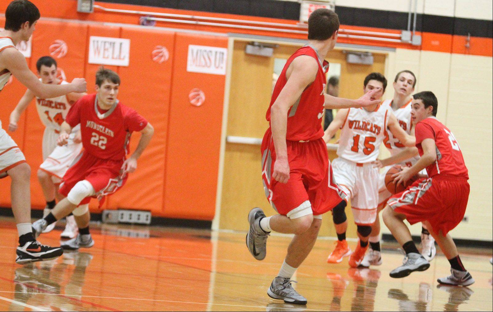 Images from the Mundelein at Libertyville boys basketball game on Friday, Feb. 8.