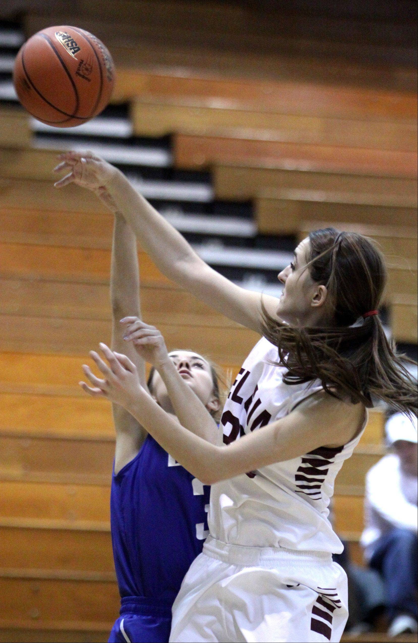 Elgin's Tamara Milosevic, right, blocks Larkin's Samantha Wahl, left, during a regional game at Streamwood High School on Monday night.