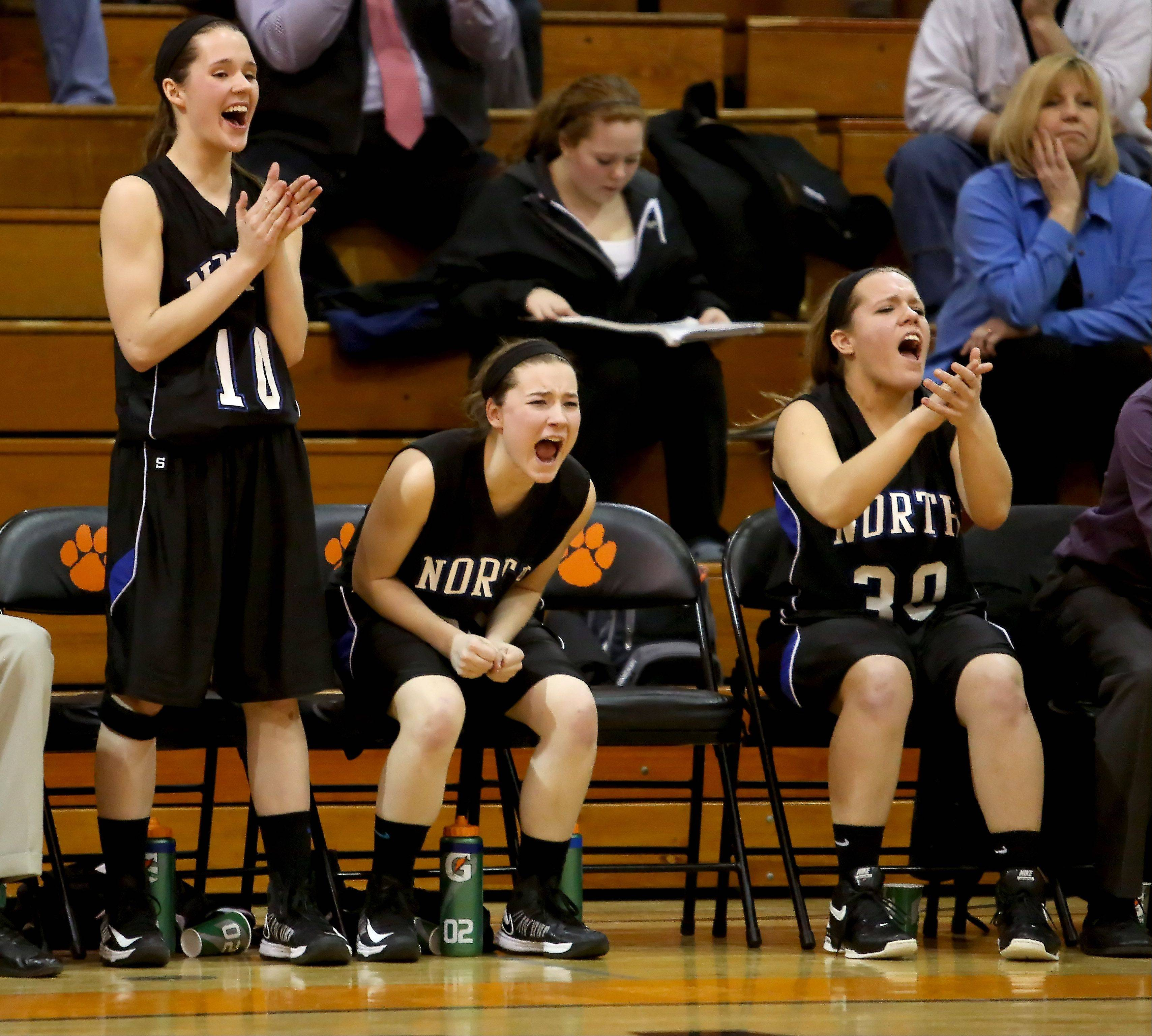 The St. Charles North bench reacts to a basket made during their win over Glenbard West in Class 4A regional quarterfinals at Wheaton Warrenville South on Monday.