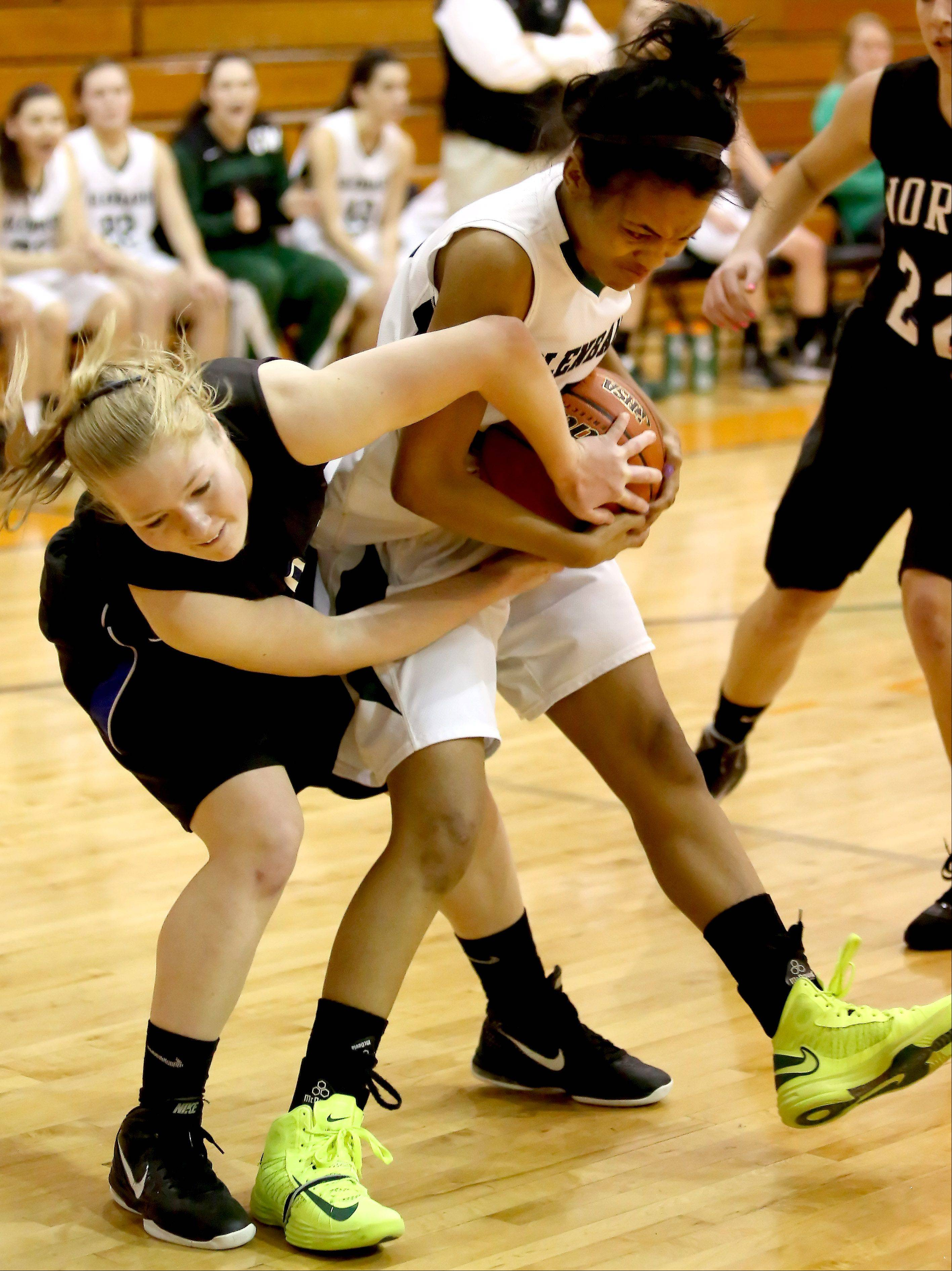 Natalie Winkates, left, of St. Charles North and Breanna Venson, right, of Glenbard West, fight for the ball during Class 4A regional quarterfinals at Wheaton Warrenville South on Monday.