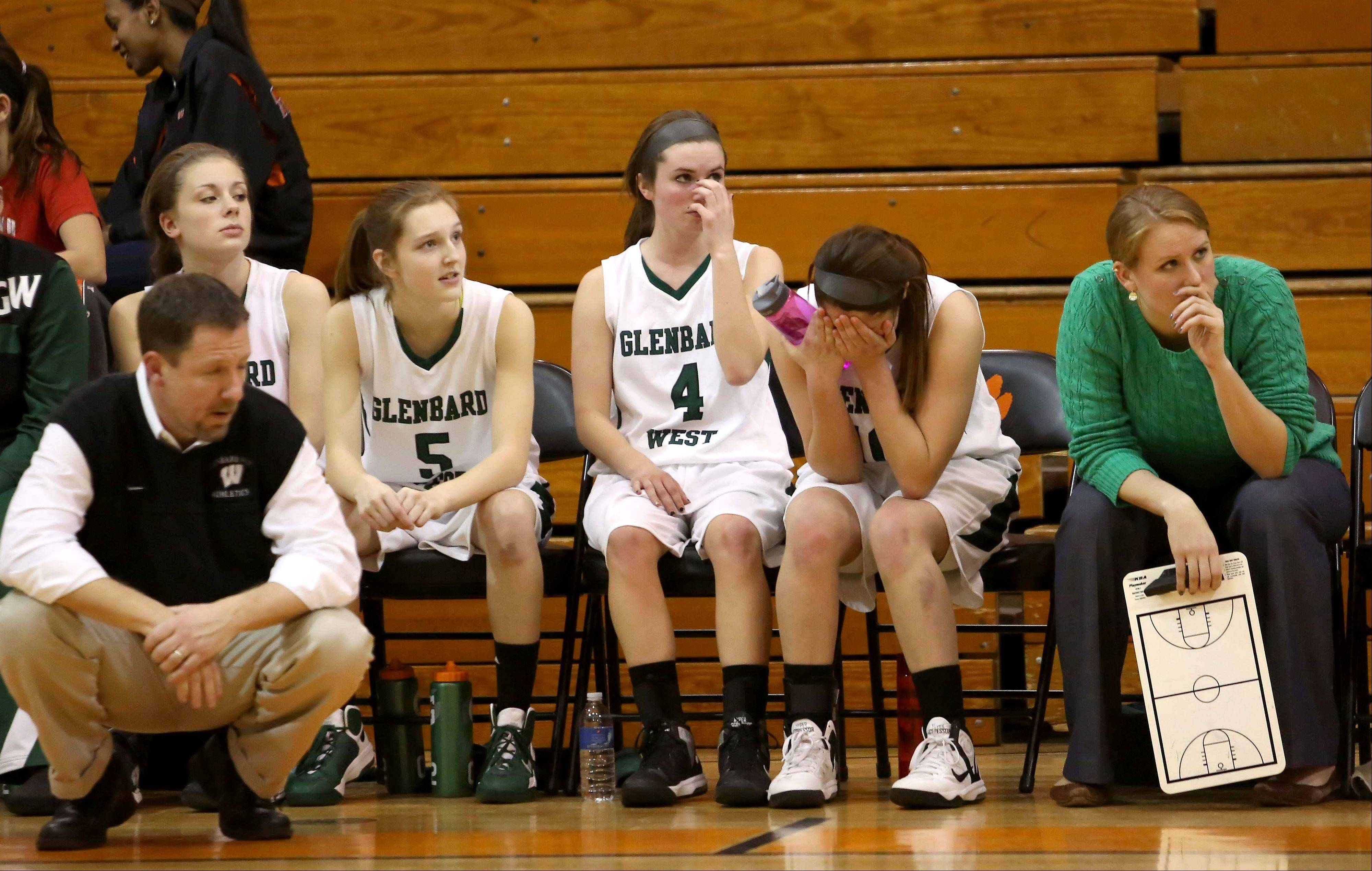 The Glenbard West bench reacts in the final seconds to their loss to St. Charles North during Class 4A regional quarterfinals at Wheaton Warrenville South on Monday.