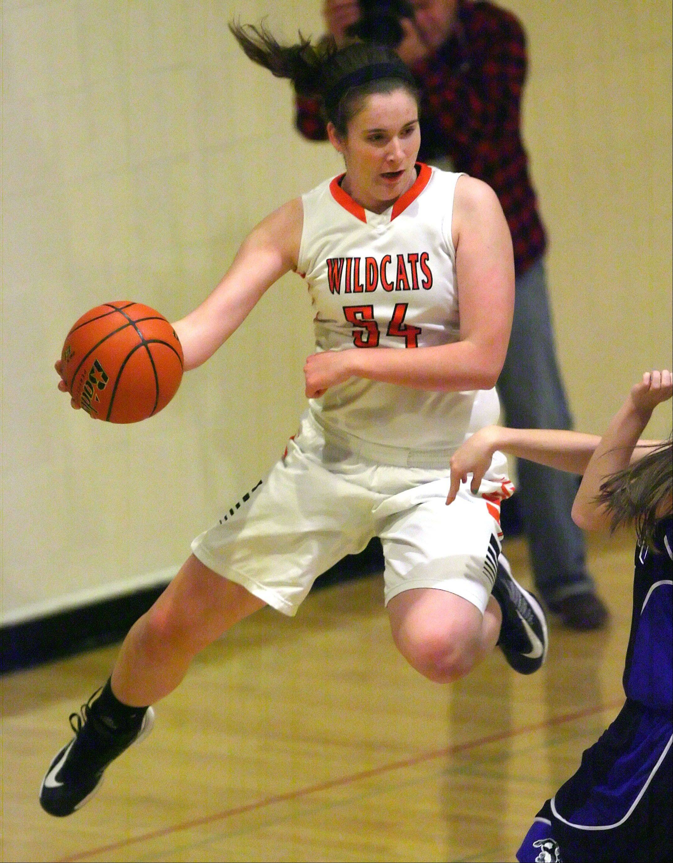 Libertyville's Becky Deichl saves the ball from going out of bounds .