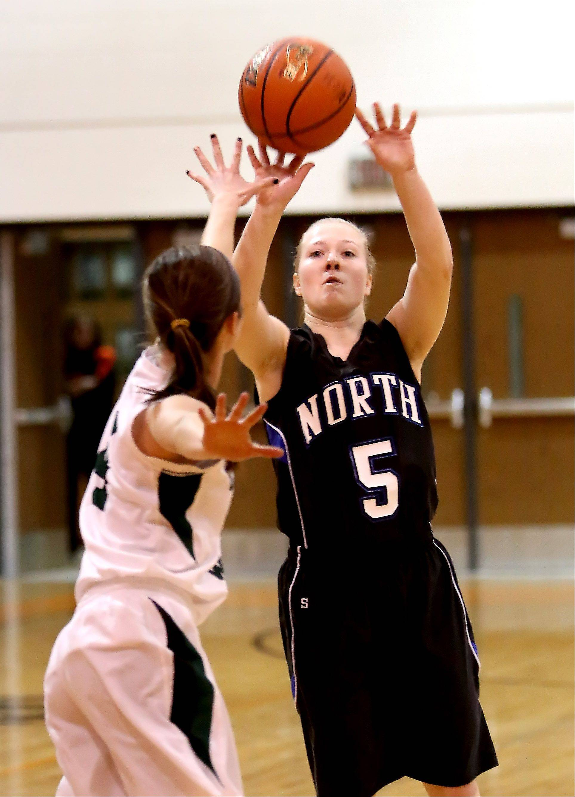 Natalie Winkates of St. Charles North goes for two points.