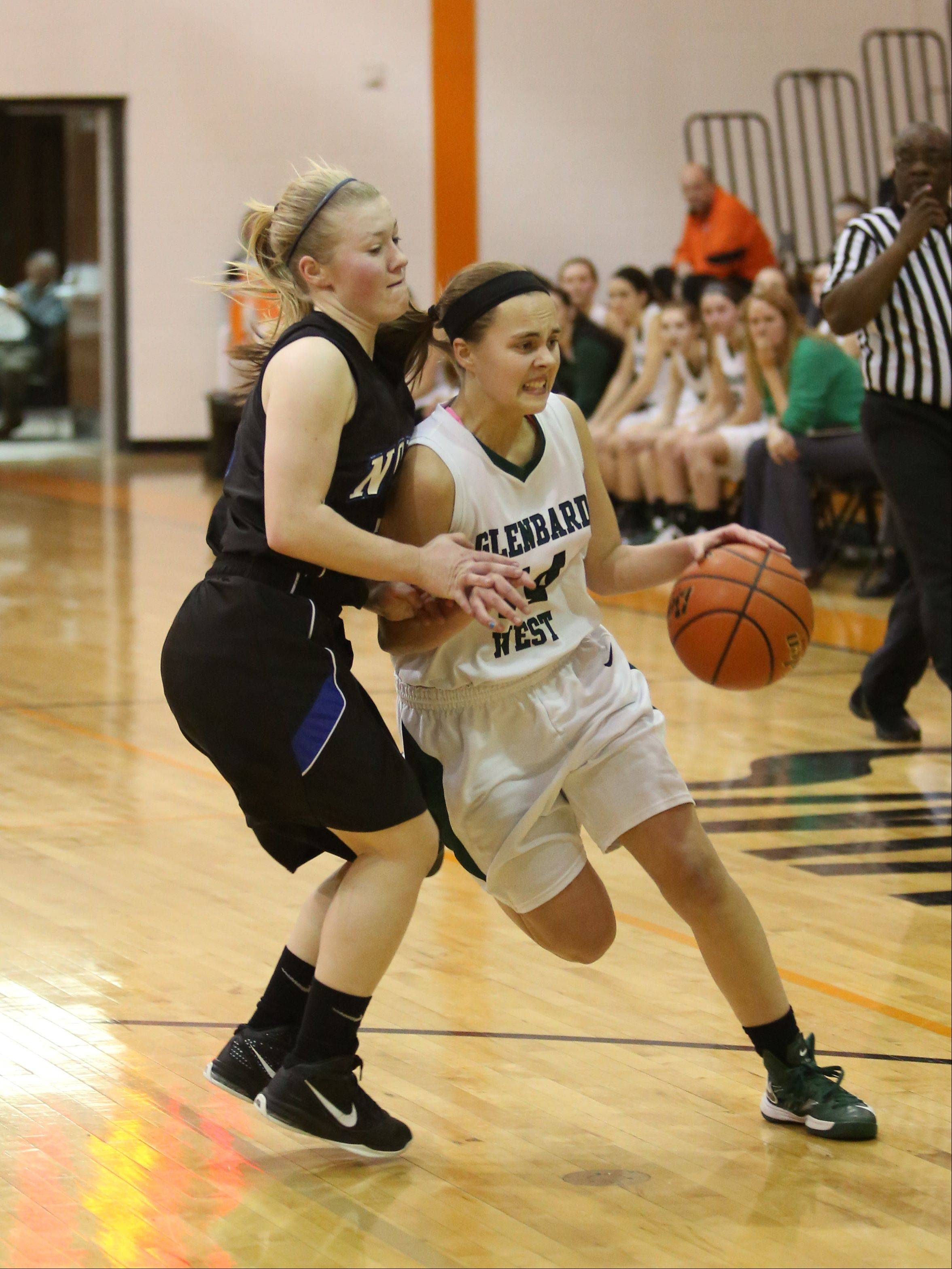 Glenbard West played St. Charles North Monday night for girls basketball Class 4A regional quarterfinal action at Wheaton Warrenville South in Wheaton.