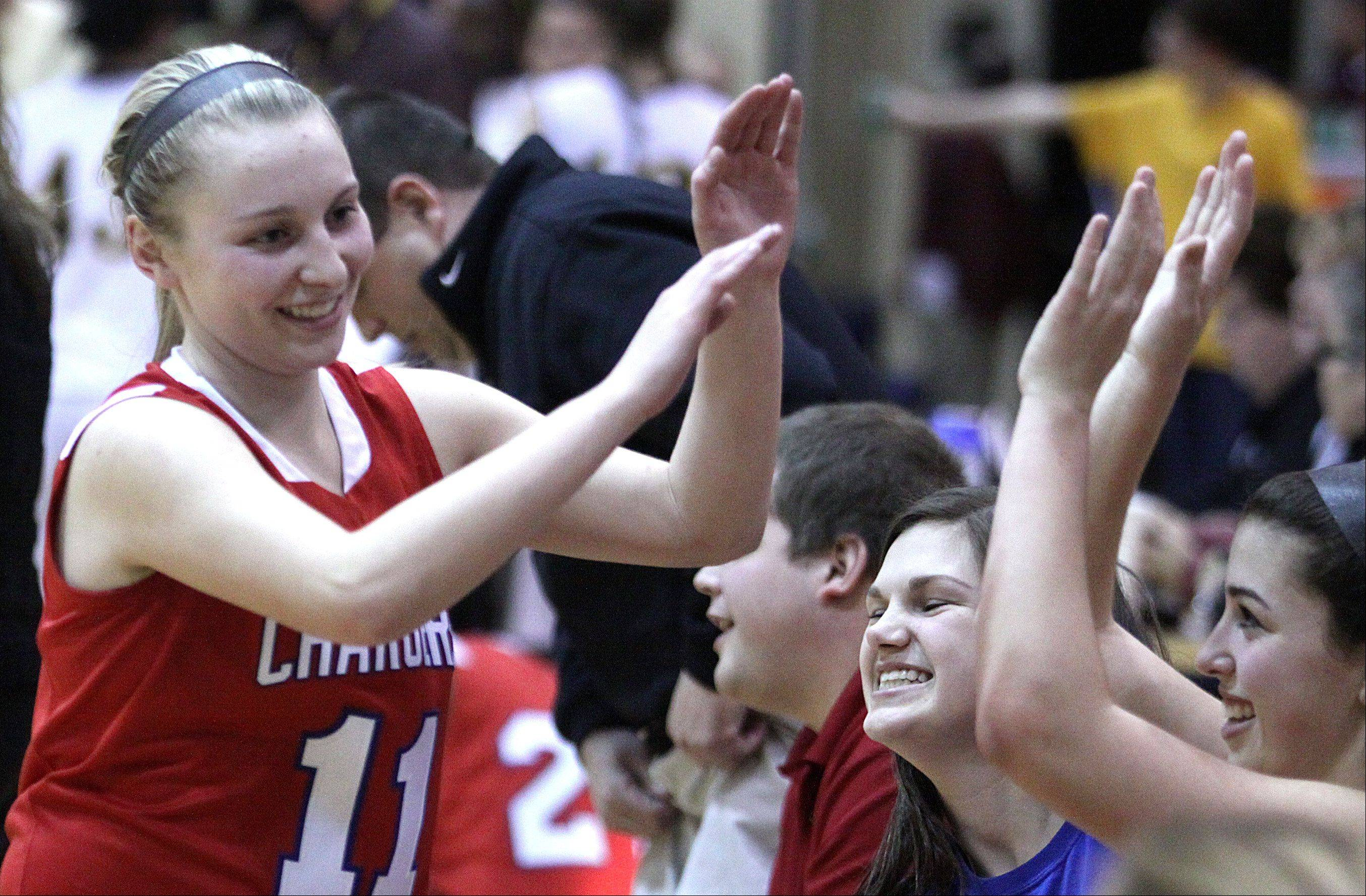 Dundee-Crown's Jordan Bartelt is all smiles as she high fives teammates at the end of a regional game against Jacobs at Streamwood High School on Monday night. Dundee-Crown won 61-45.