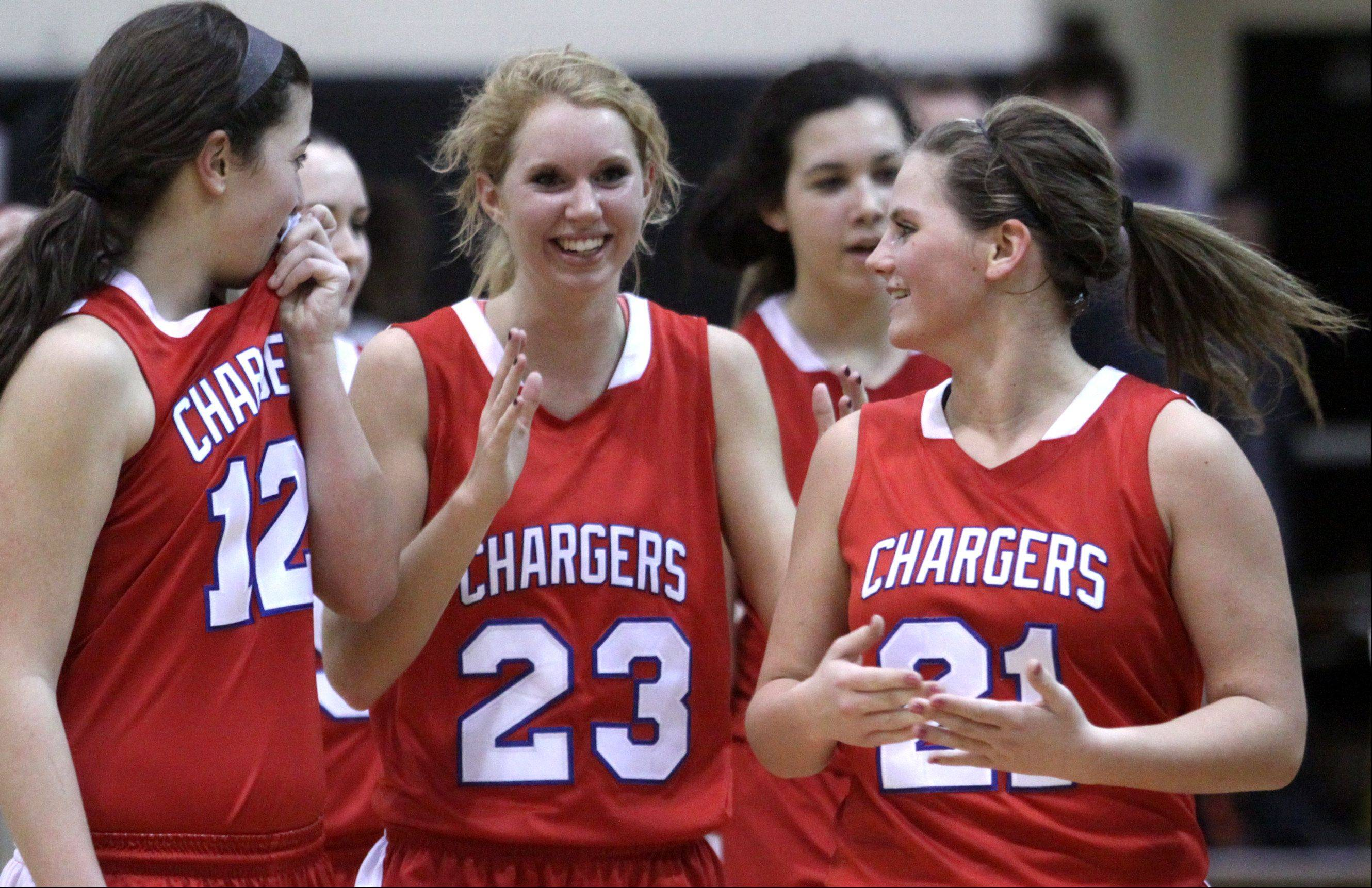 From left, Dundee-Crown's Lauren Lococo, Jillian Weichmann, and Stephanie Magsamen are all smiles after beating Jacobs in a regional game at Streamwood High School on Monday night. Dundee-Crown won 61-45.