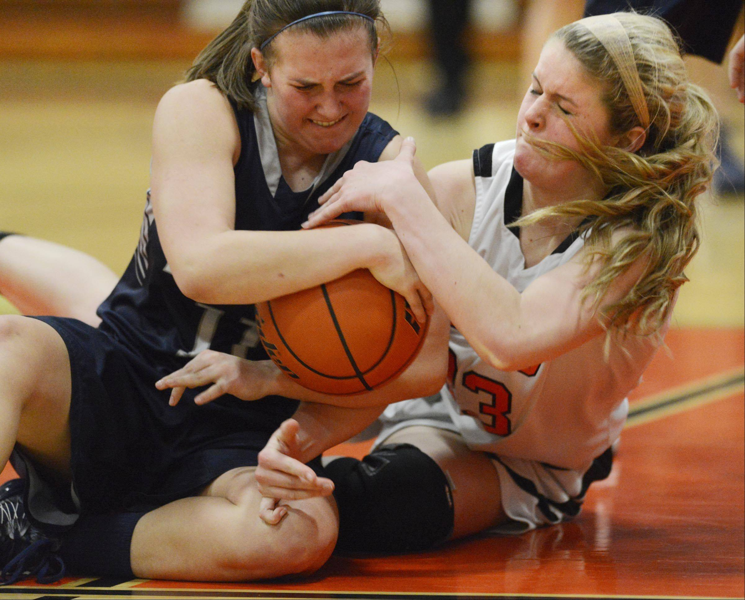 St. Charles East's Hannah Nowling and Lake Park's Emily Duckhorn struggle for the ball.