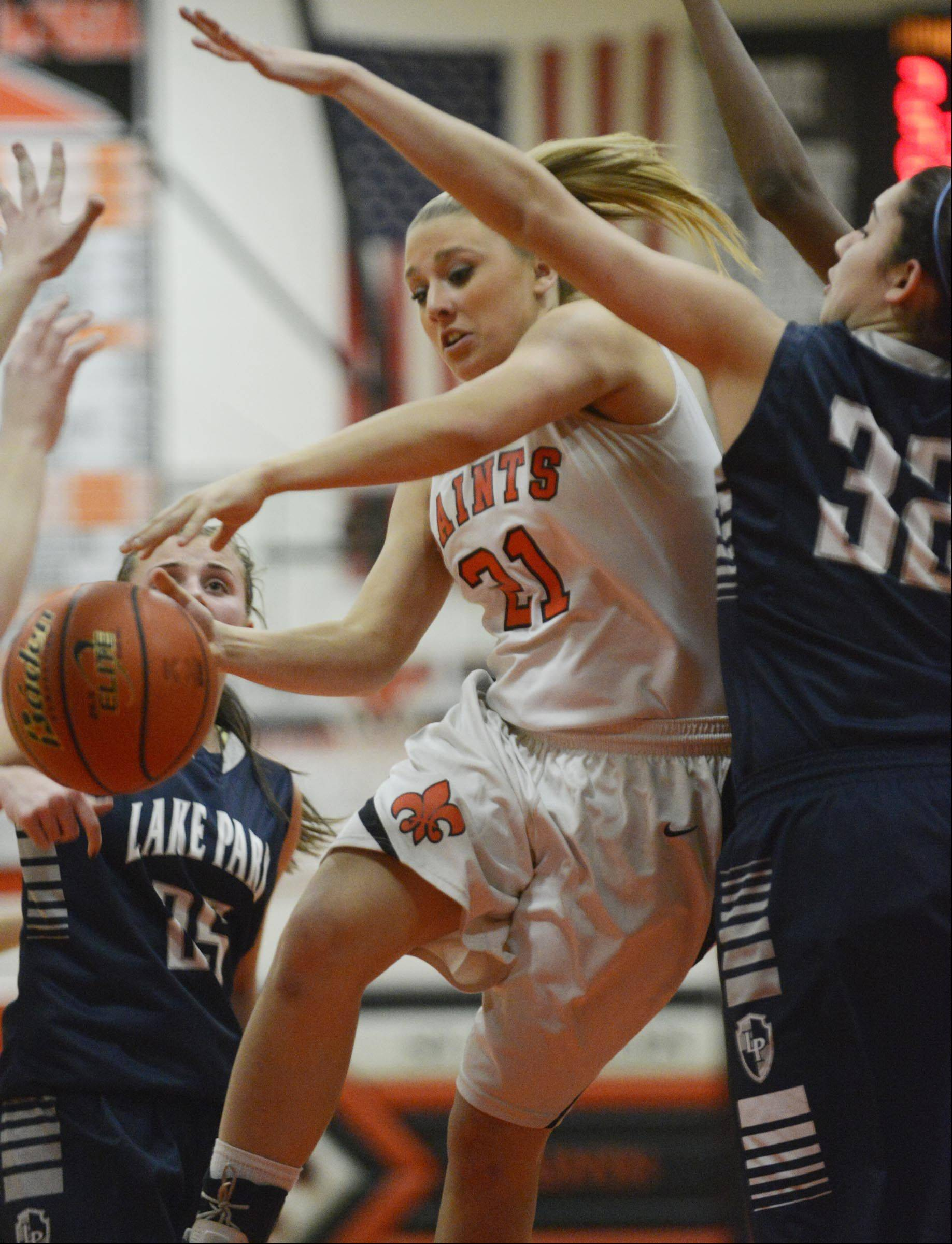 St. Charles East's Katie Claussner loses control of the ball against Lake Park's Maria Zepeda .