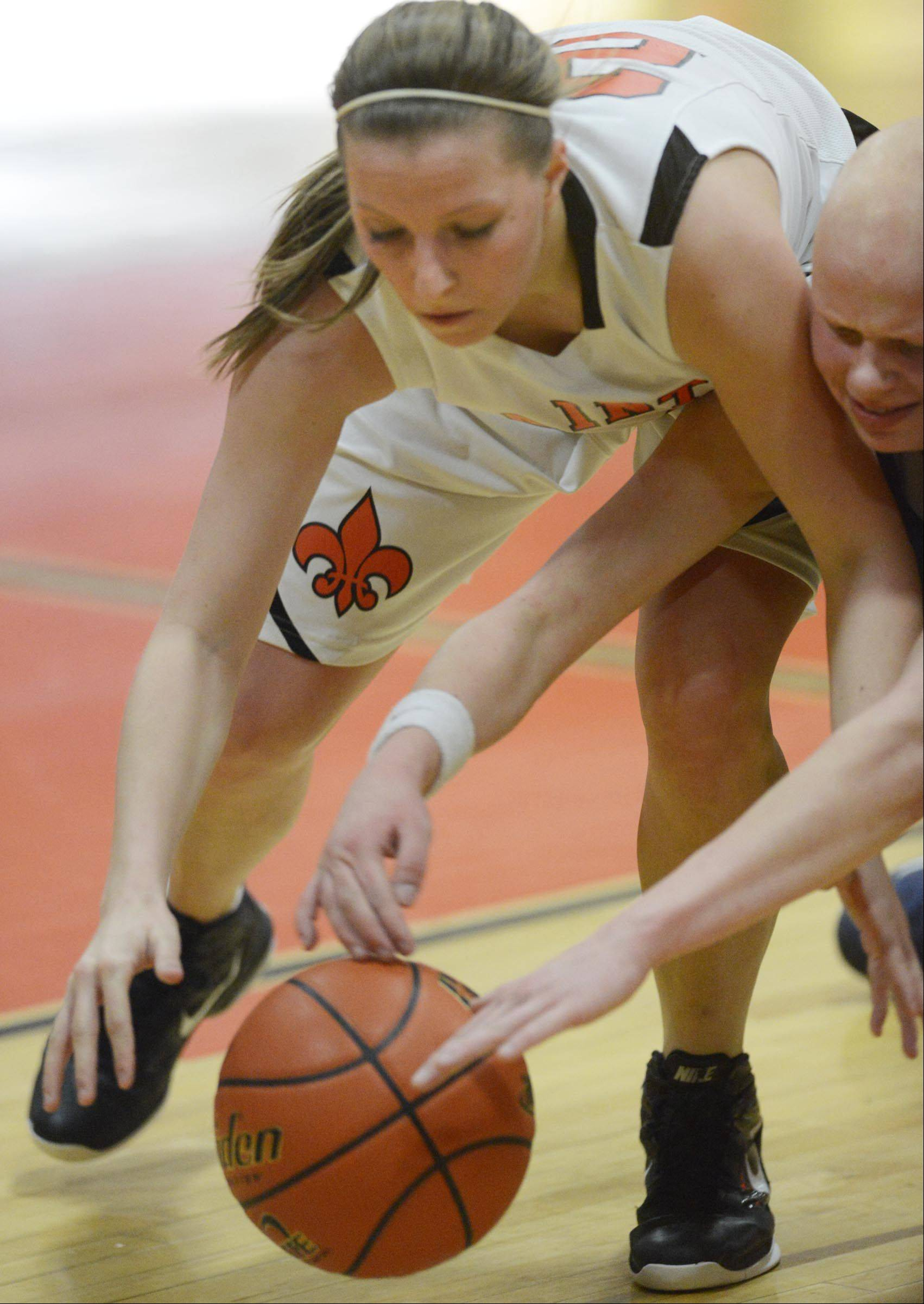 St. Charles East's Laney Deckrow and Lake Park's Sam Cummings stretch for a loose ball.