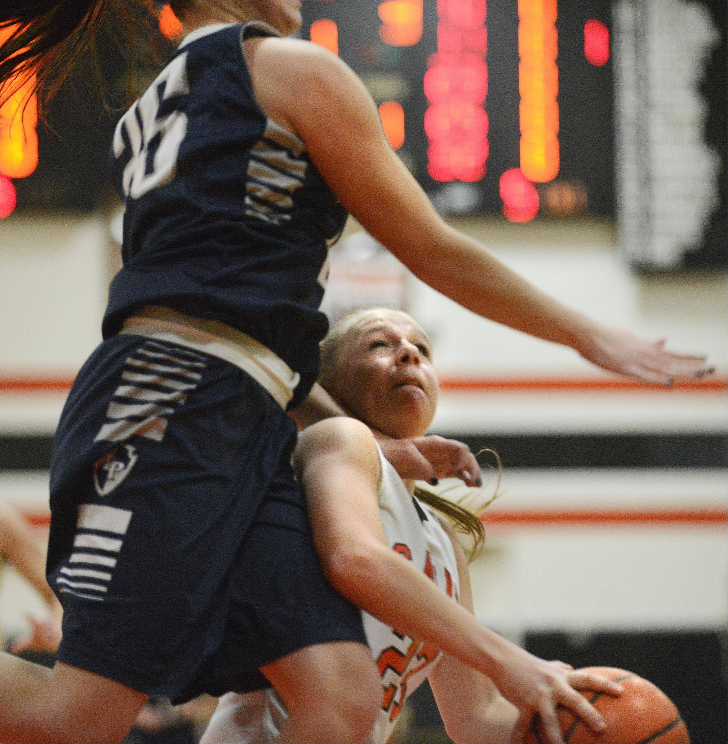 St. Charles East's Amanda Hilton is fouled by Lake Park's Nicole Tsiodras.