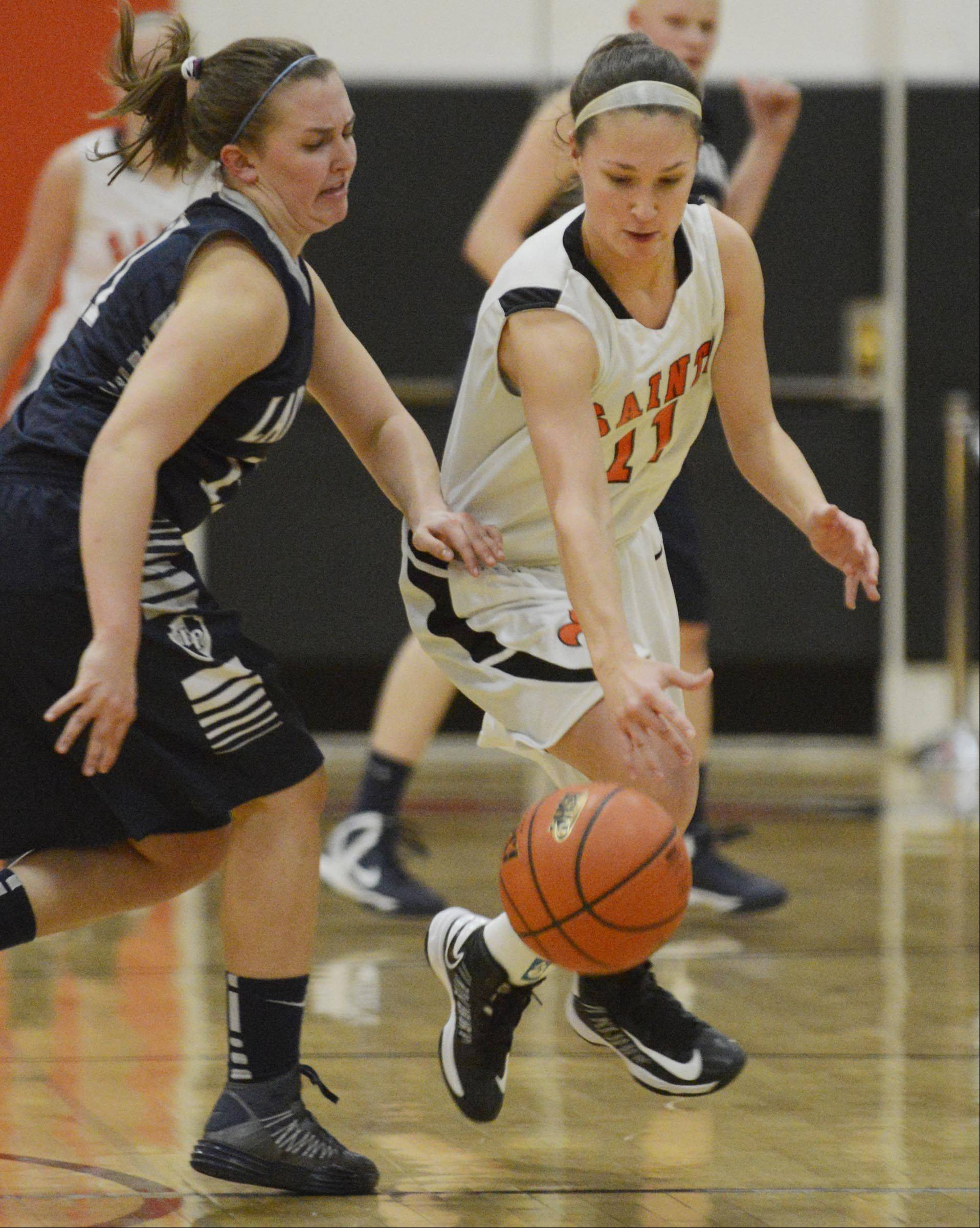 St. Charles East's Carly Pottle steals the ball from Lake Park's Emily Duckhorn.