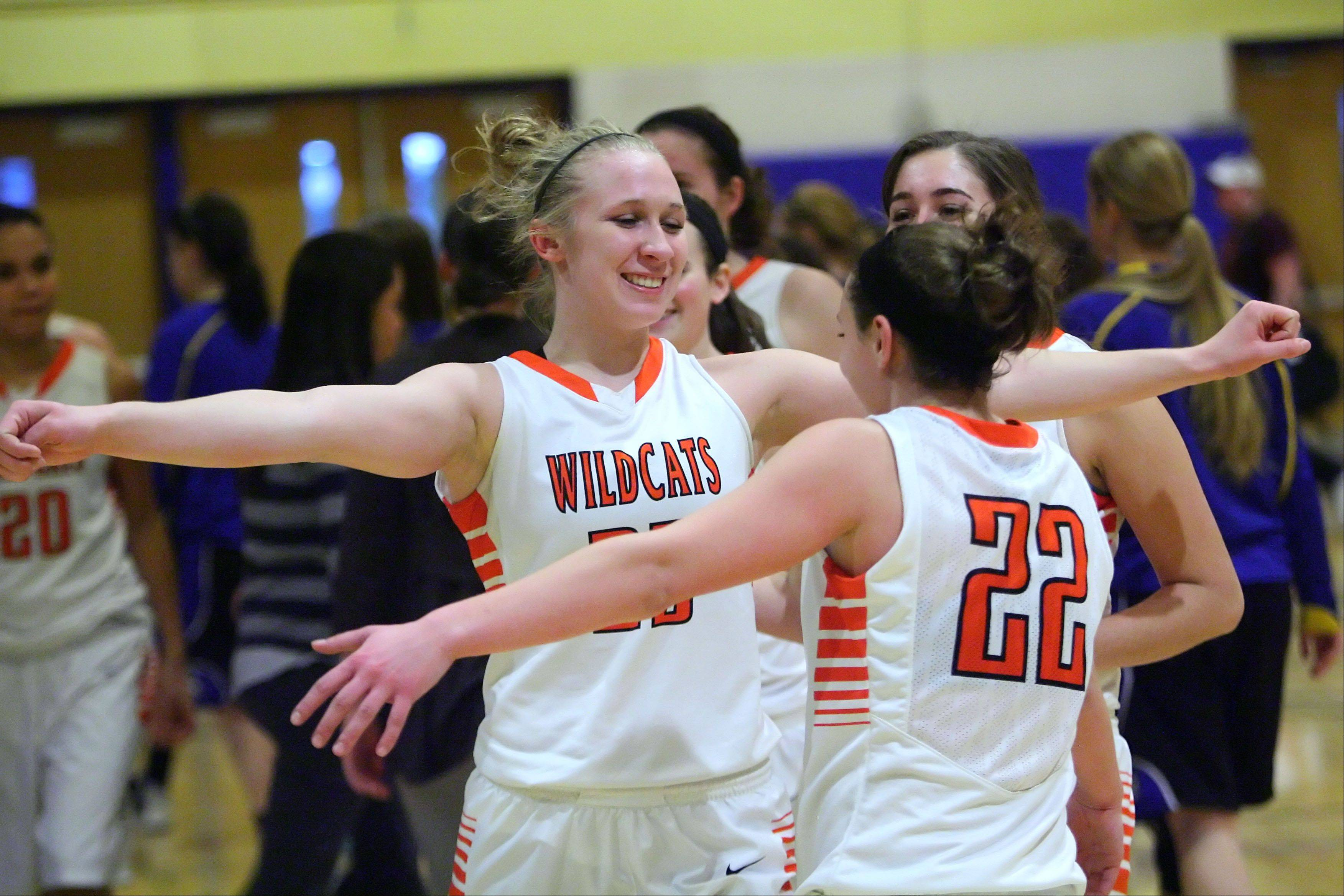 Libertyville's Dana Kym, left, and Olivia Mayer celebrate after beating Wheeling in a Class 4A regional play-in game Monday night at Wheeling.
