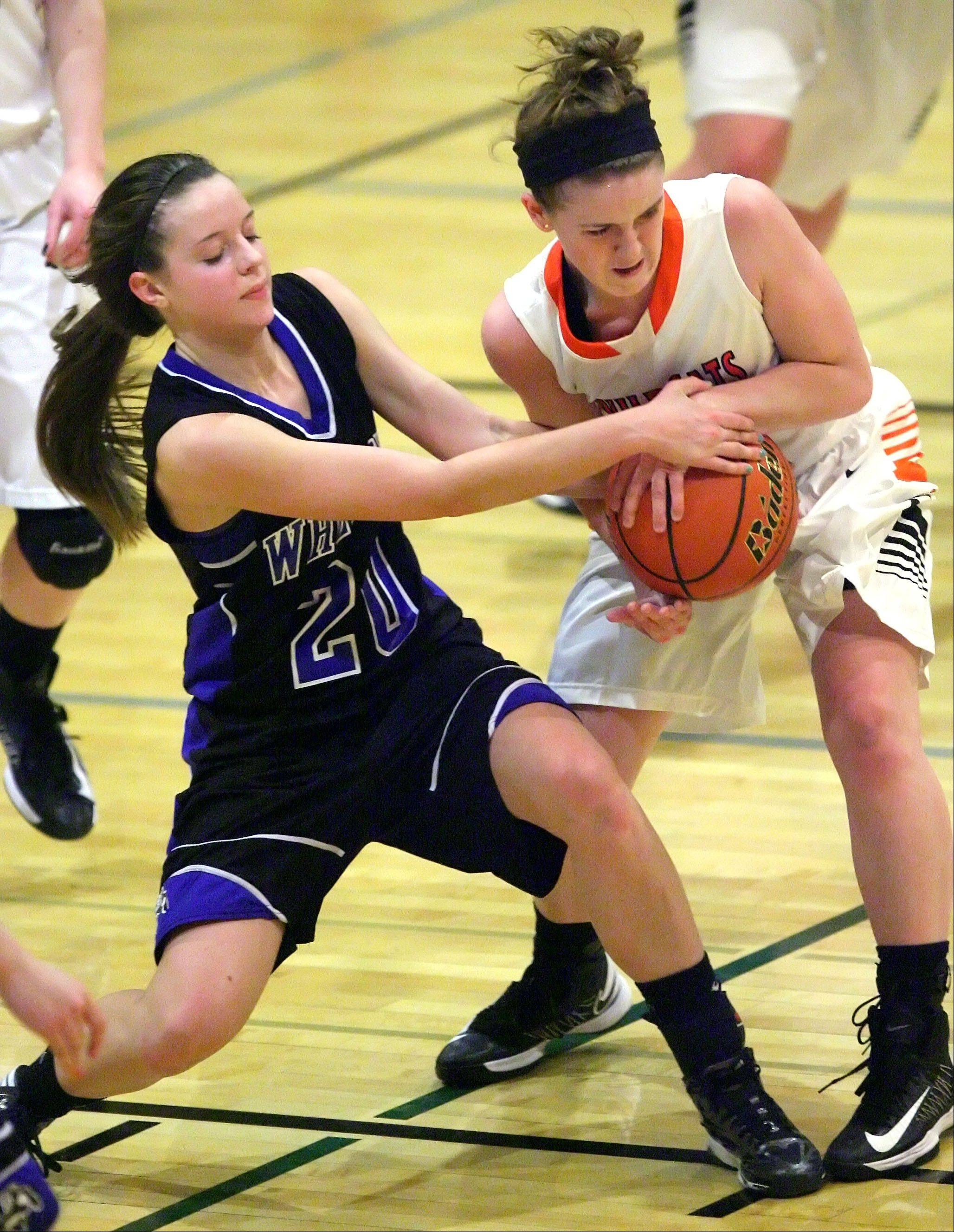 Steve Lundy/slundy@dailyherald.com Wheeling's Elizabeth Smith, left, and Libertyville's Rosie Lynch battle for a loose ball during a Class 4A regional play-in game Monday night at Wheeling.