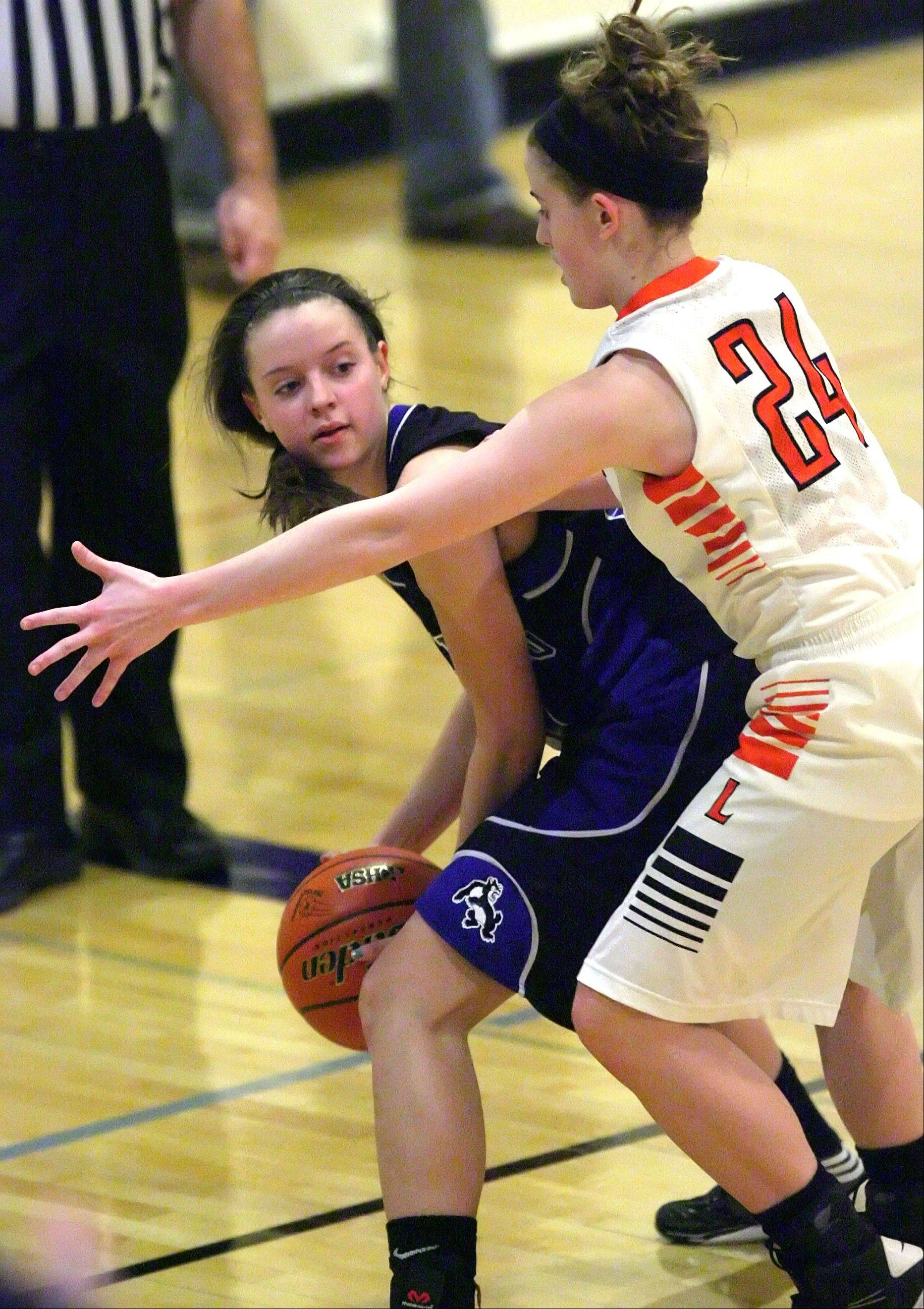Steve Lundy/slundy@dailyherald.com Wheeling's Elizabeth Smith, left, is trapped in the corner by Libertyville's Rosie Lynch during Class 4A regional play-in action Monday night at Wheeling.