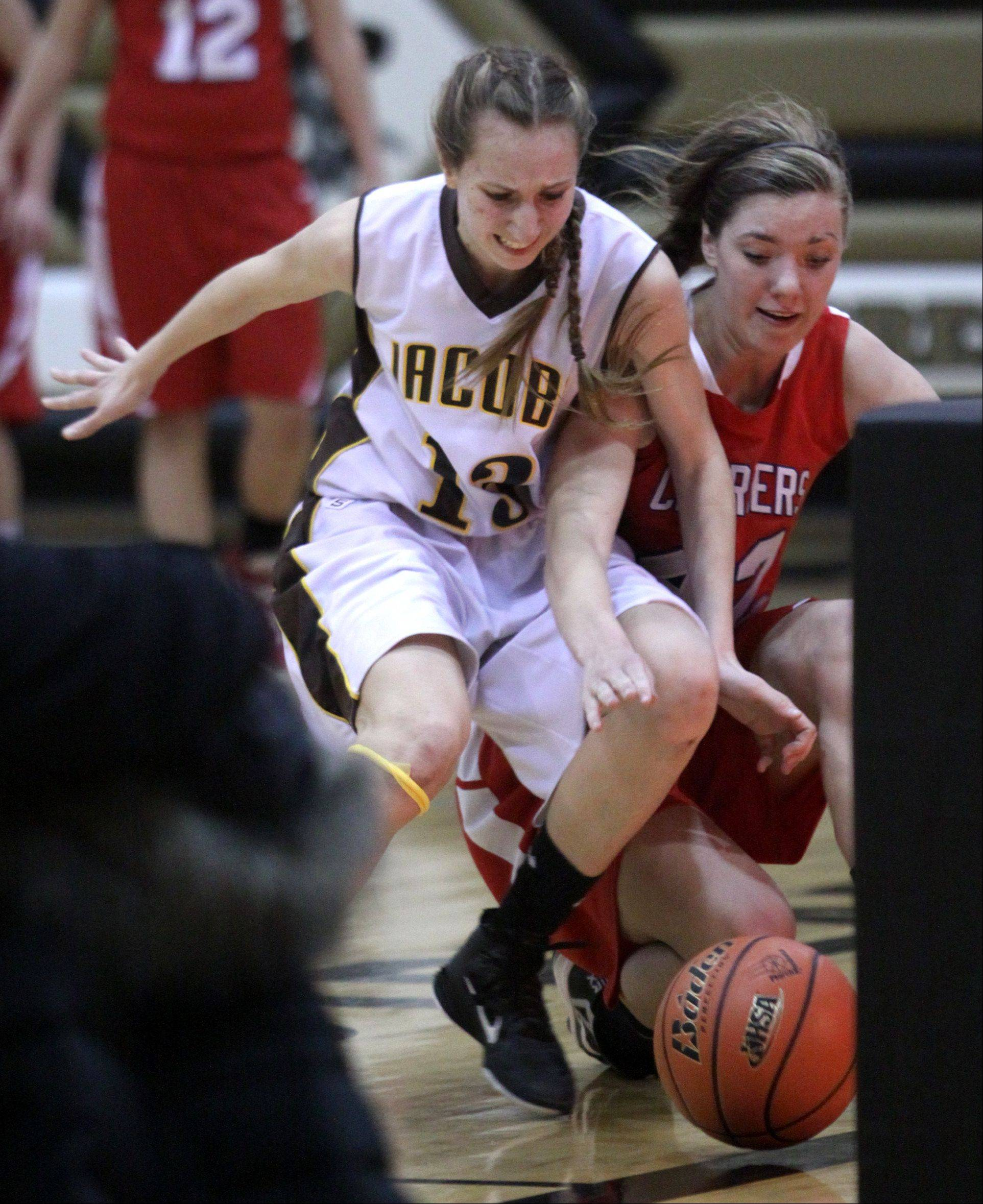 Dundee-Crown's Emily Michalski, right, races Jacobs' Victoria Tamburrino to the ball.