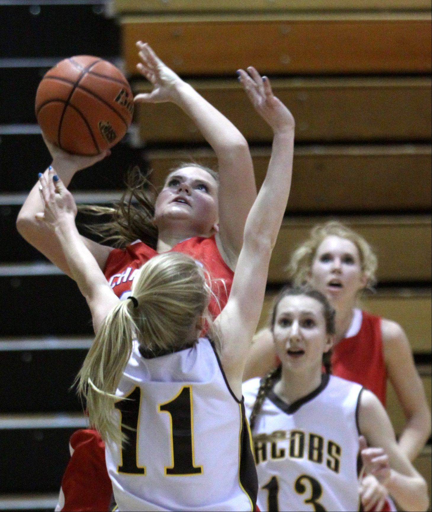 Dundee-Crown's Stephanie Magsamen goes to the hoop against Jacobs.