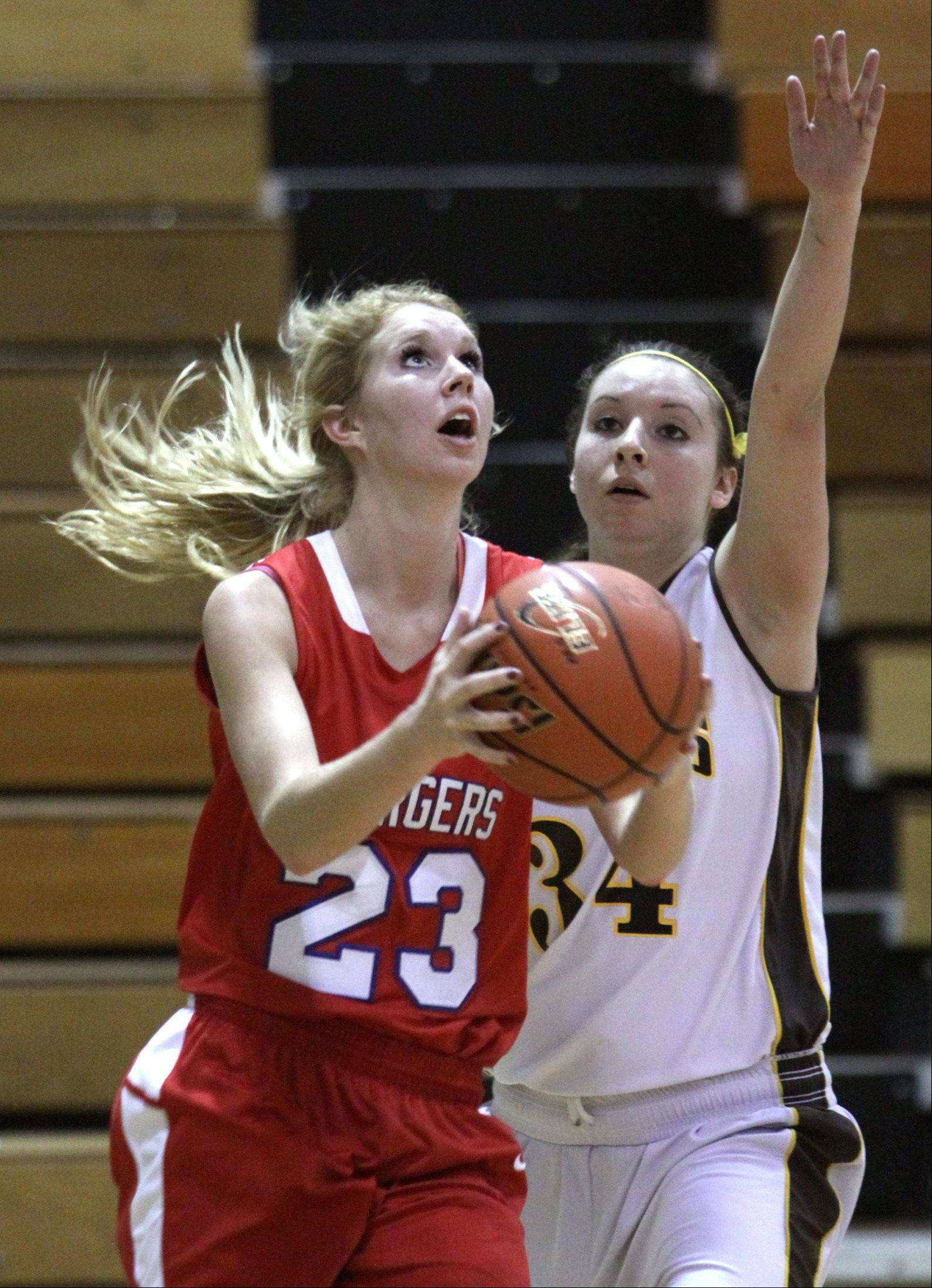 Dundee-Crown's Jillian Weichmann goes to the hoop past Jacobs' Jennifer Barnec.