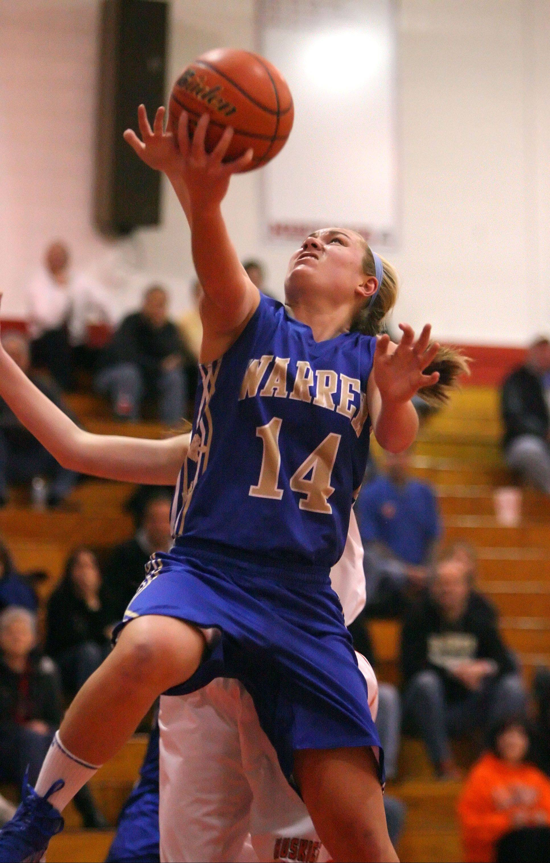 Warren's Kristen O'Brien drives to the hoop during Class 4A regional semifinal play against Hersey on Tuesday night at Mundelein.